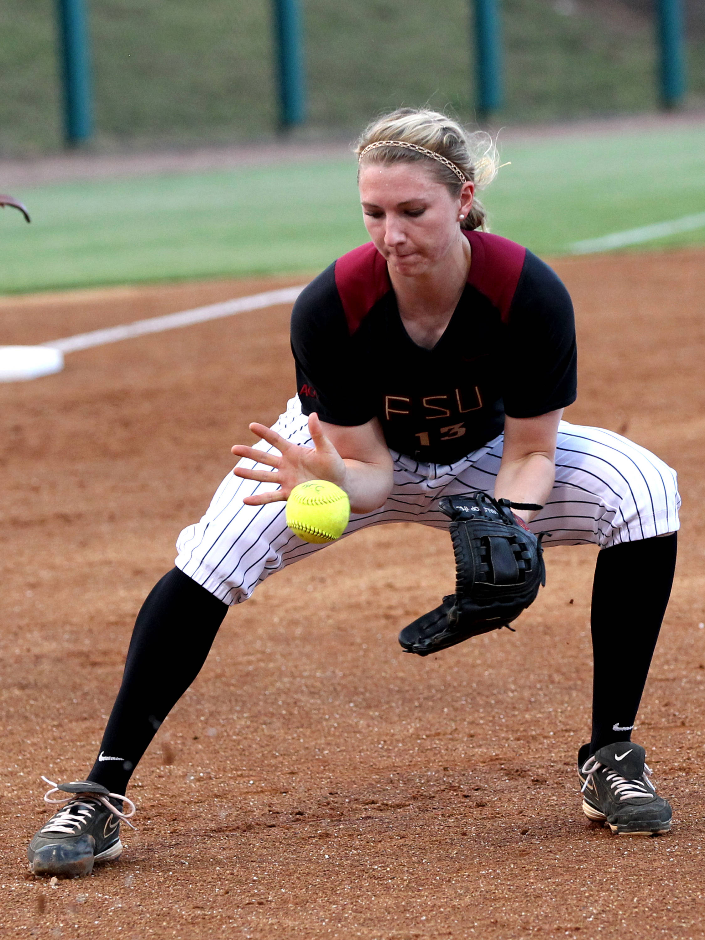 Pitcher Lacey Waldrop fielding her position, FSU vs Virginia, 04/13/13 . (Photo by Steve Musco)
