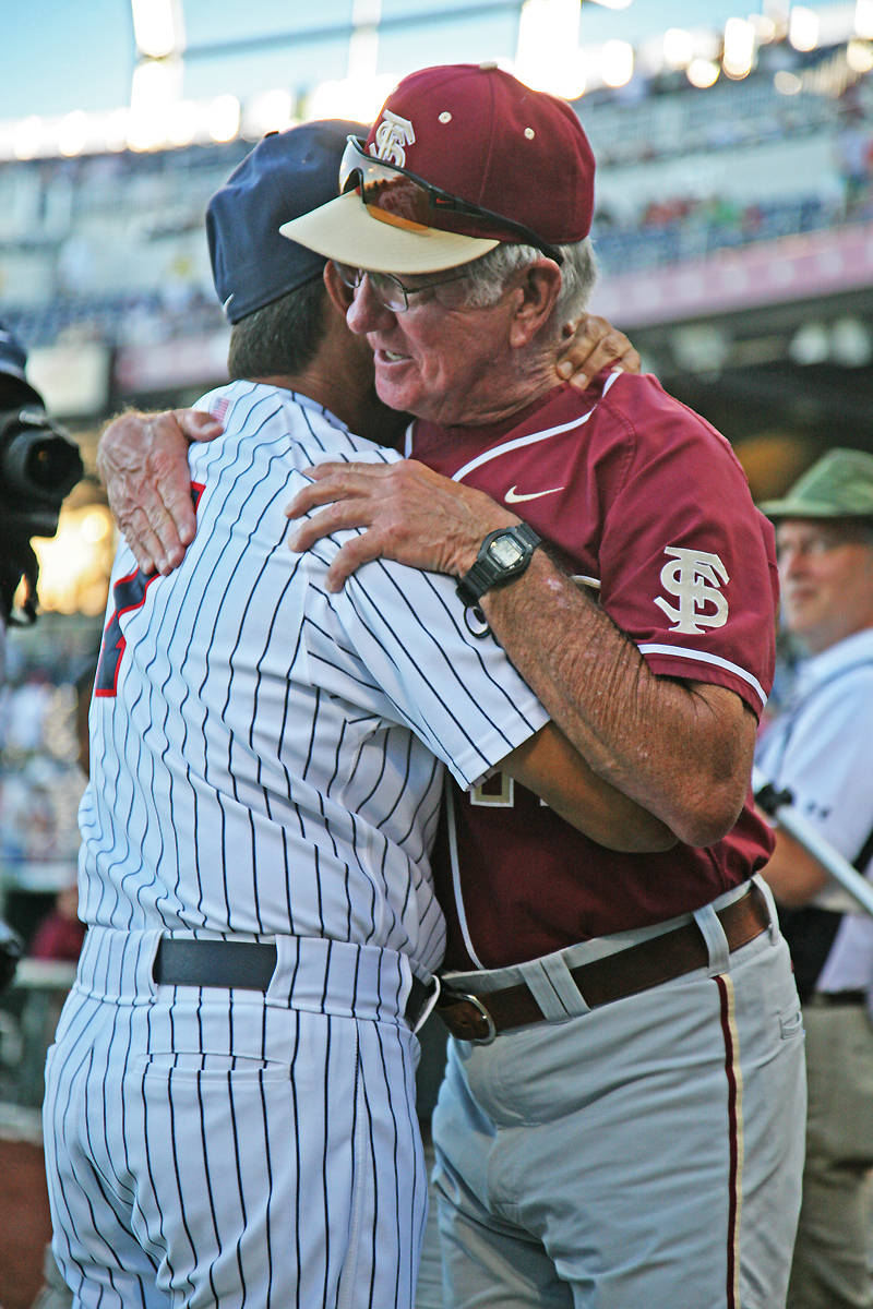 Arizona head coach Andy Lopez and head coach Mike Martin share a hug at the end of the game.