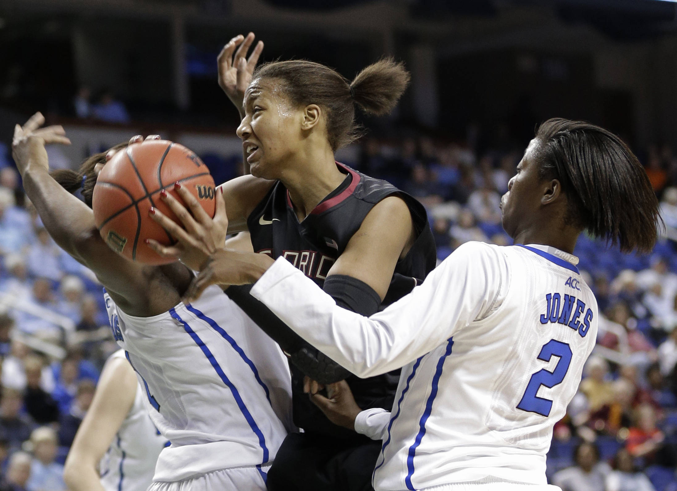 Florida State's Chelsea Davis, center, drives between Duke's Alexis Jones, right, and Elizabeth Williams. (AP Photo/Chuck Burton)