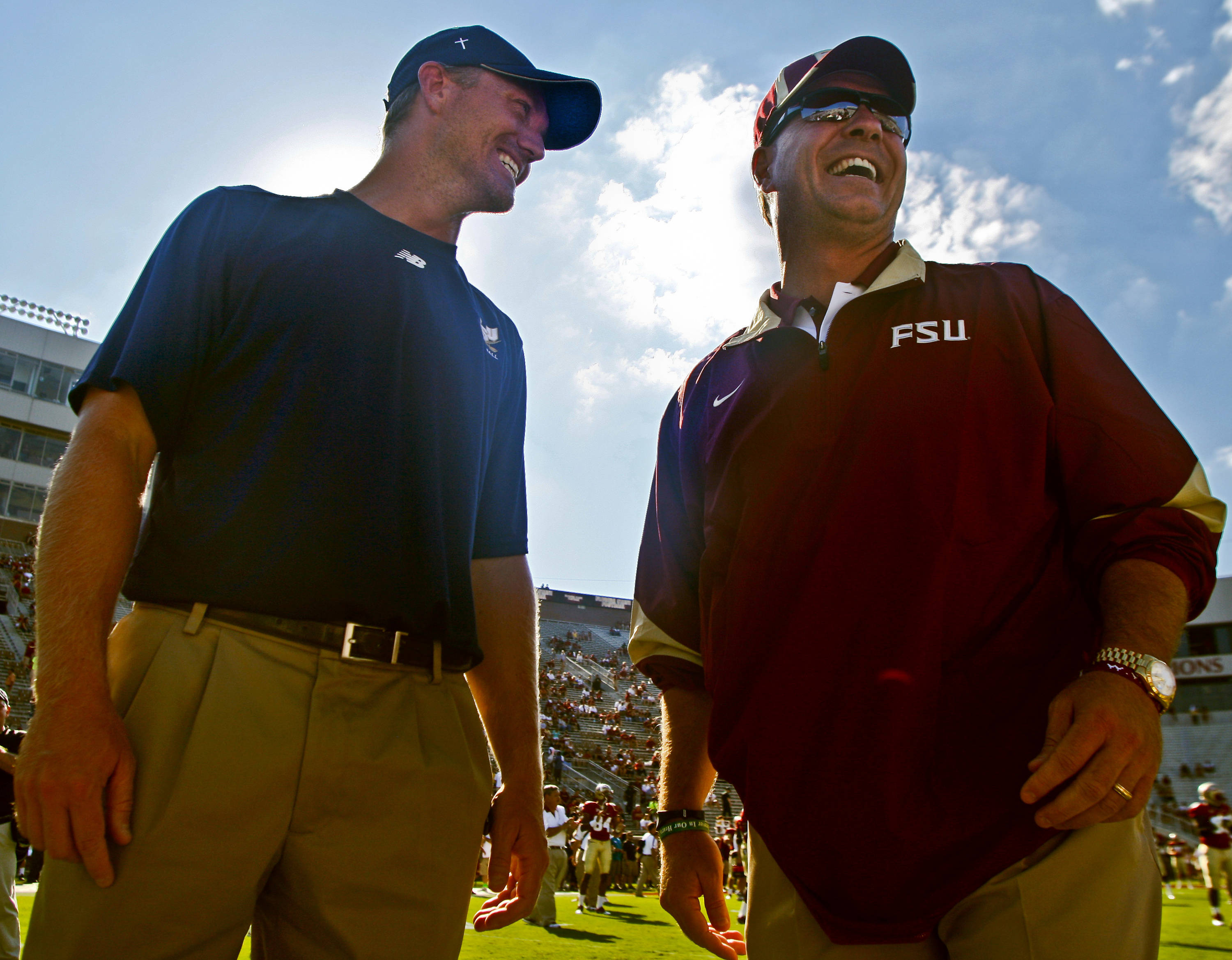 Charleston Southern offensive coordinator Patrick Nix laughs with Florida State head coach Jimbo Fisher, right, prior to the start of an NCAA college football game on Saturday, Sept. 10, 2011, in Tallahassee, Fla. Nix was a quarterback at Auburn in the mid-90s while Fisher was the quarterback coach there. (AP Photo/Phil Sears)