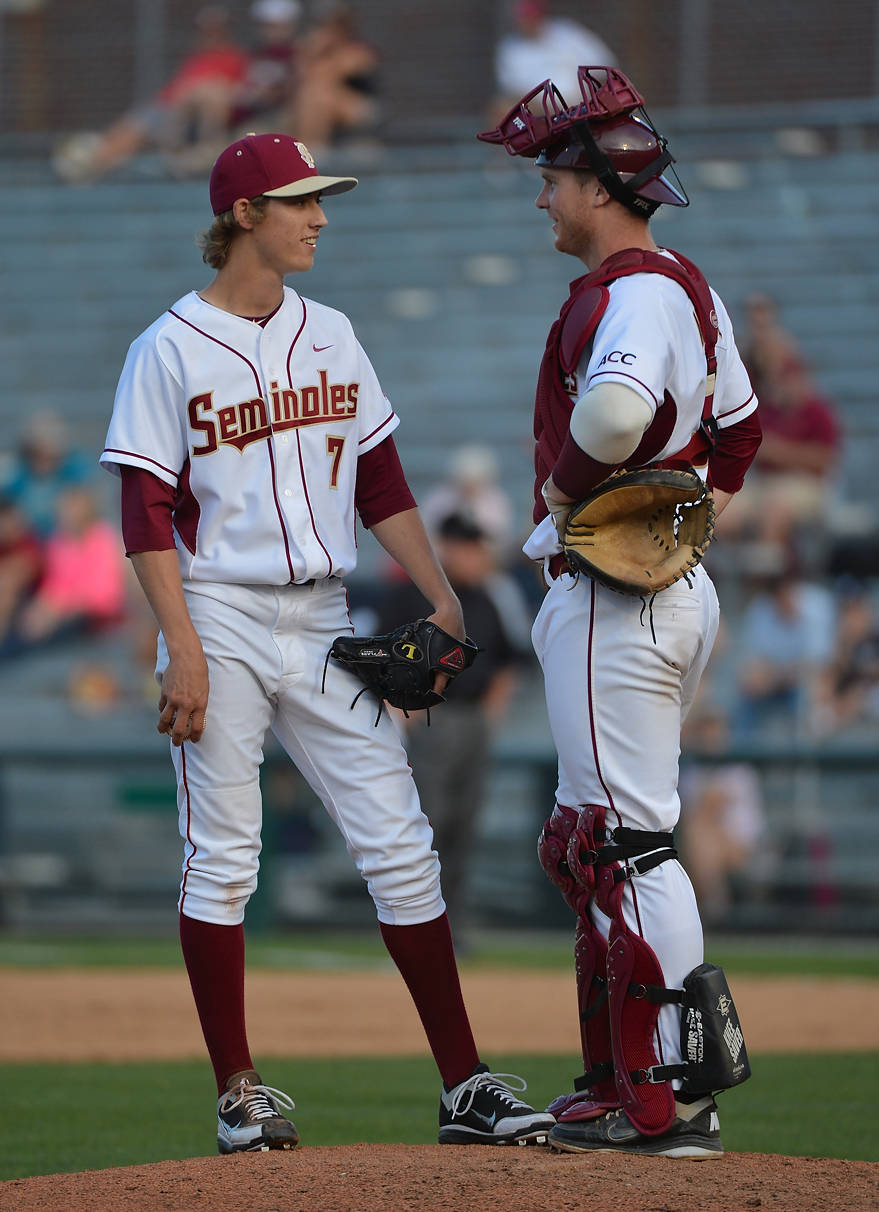 Luke Weaver and Stephen McGee meet at the mound