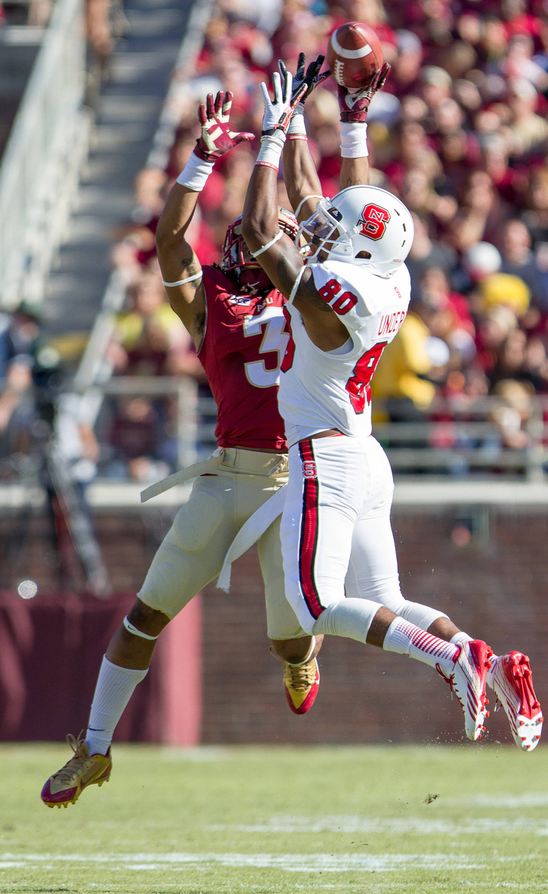 Ronald Darby (3) breaks up a pass during FSU Football's 49-17 win over NC State on Saturday, October 26, 2013 in Tallahassee, Fla. Photo by Michael Schwarz.