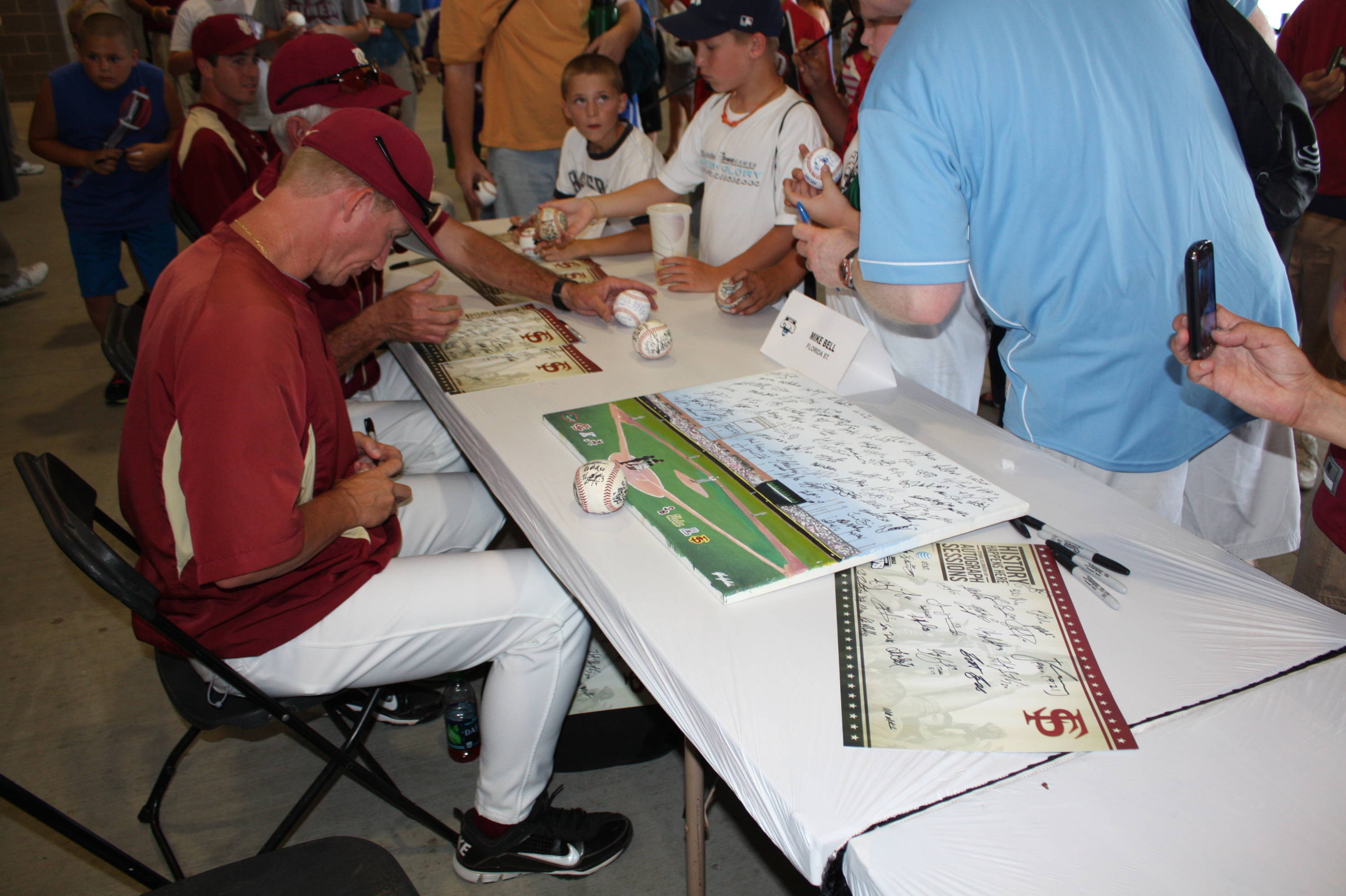 CWS autograph session - associate head coach Mike Bell