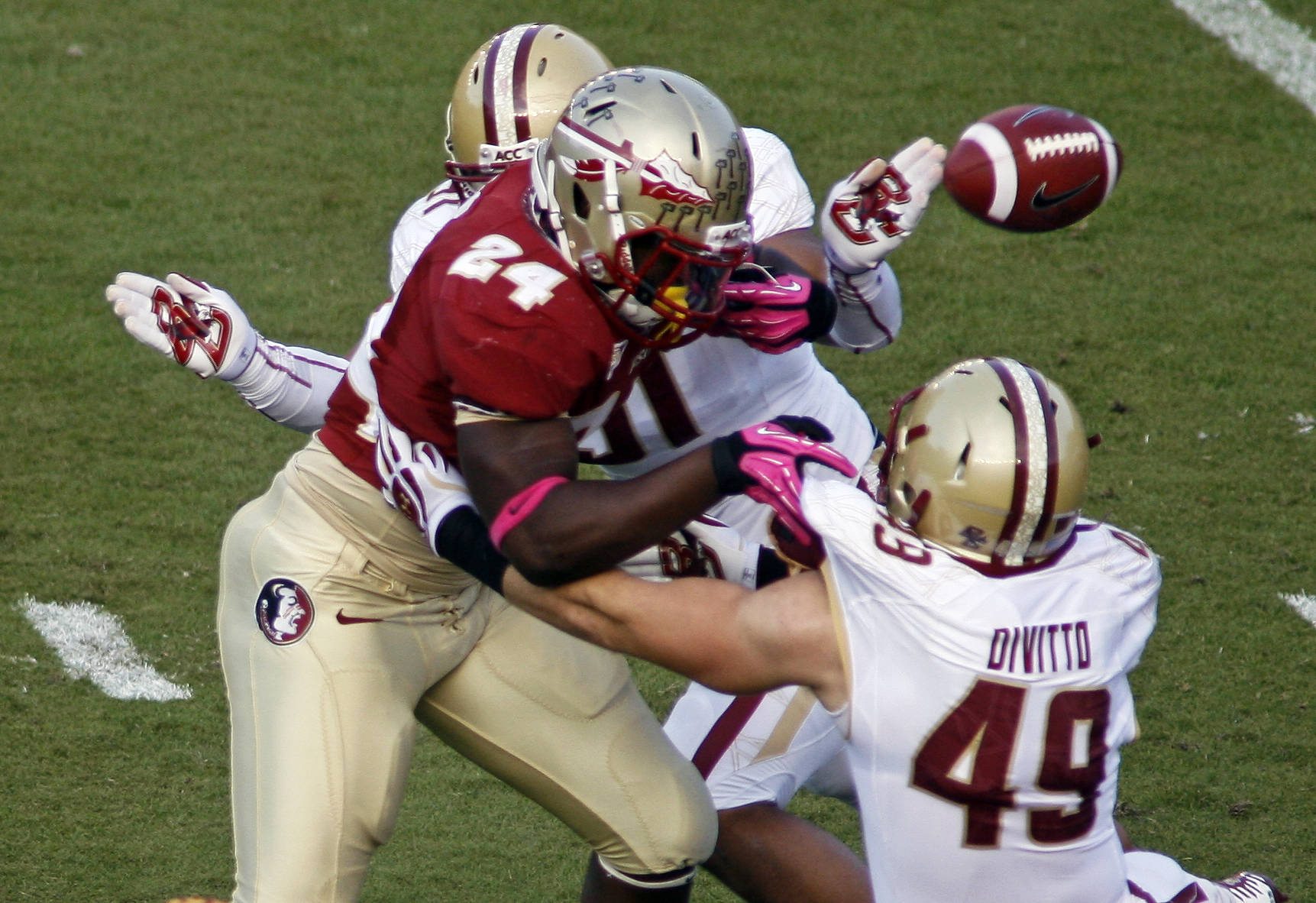 Florida State fullback Lonnie Pryor (24) is hammered by Boston College defensive end Kasim Edebali (91), causing him to fumble the ball in the first quarter. (AP Photo/Phil Sears)