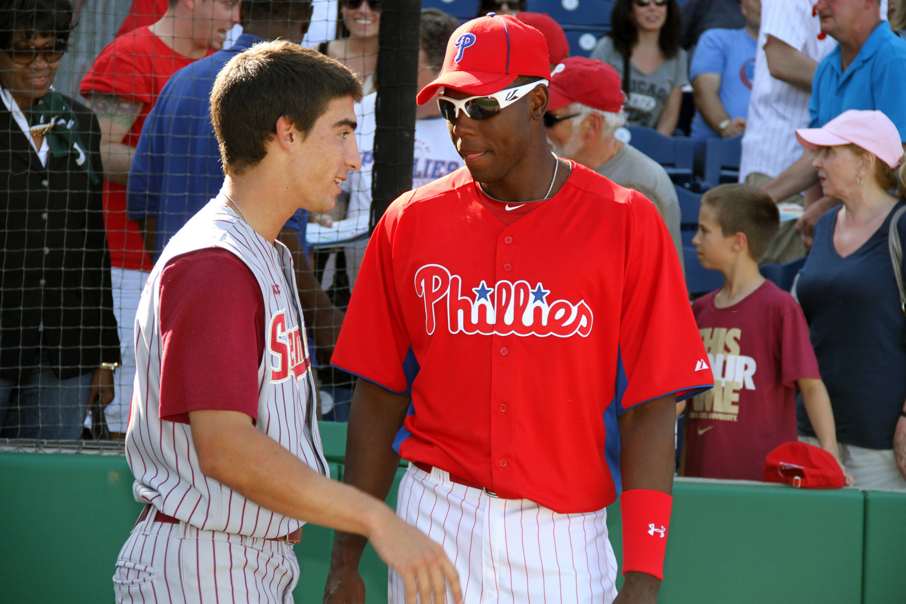 Justin Gonzalez talks with John Mayberry, Jr., during batting practice.