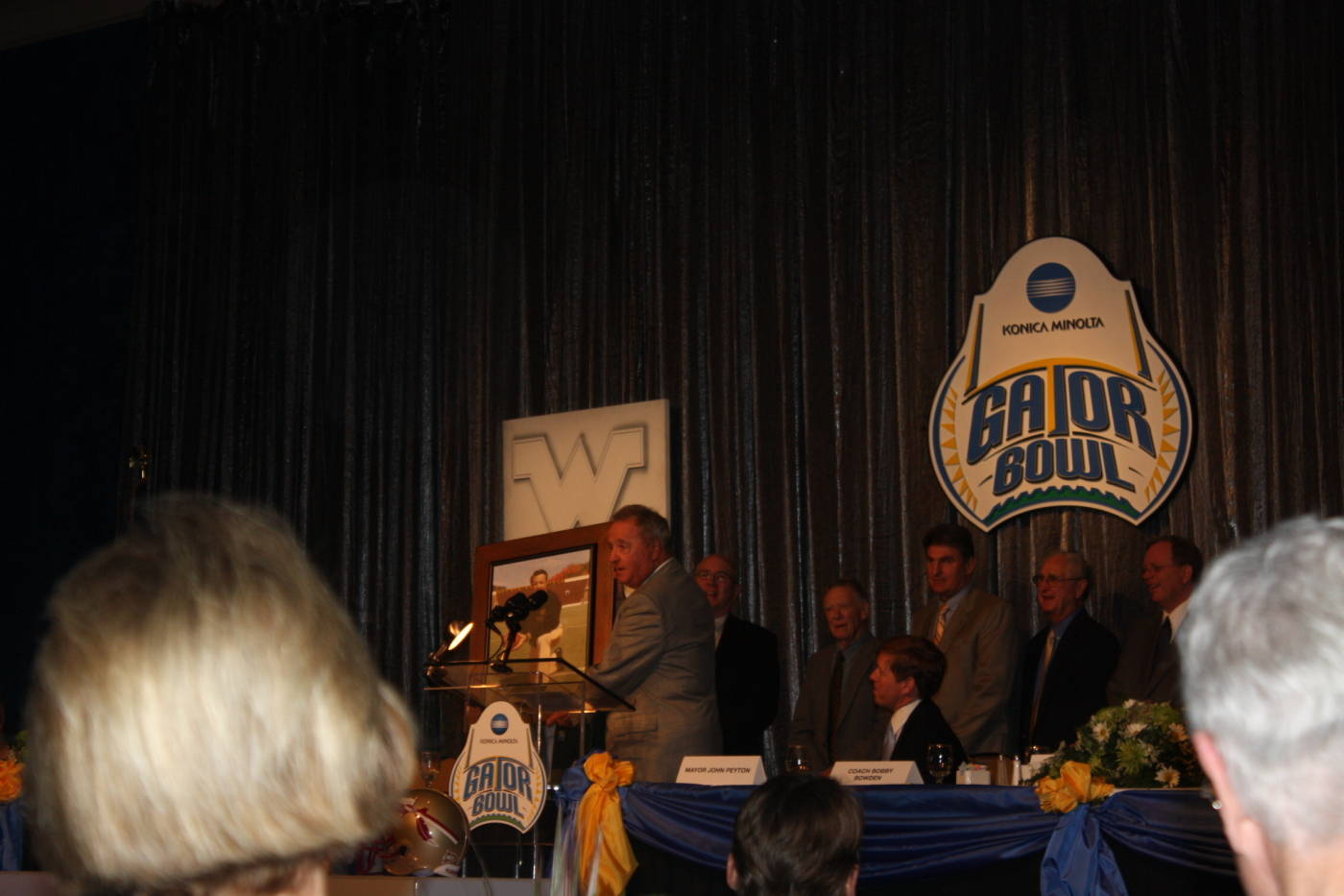 FSU head coach Bobby Bowden receives a gift from West Virginia at the Gator Bowl Luncheon and Hall of Fame Induction.