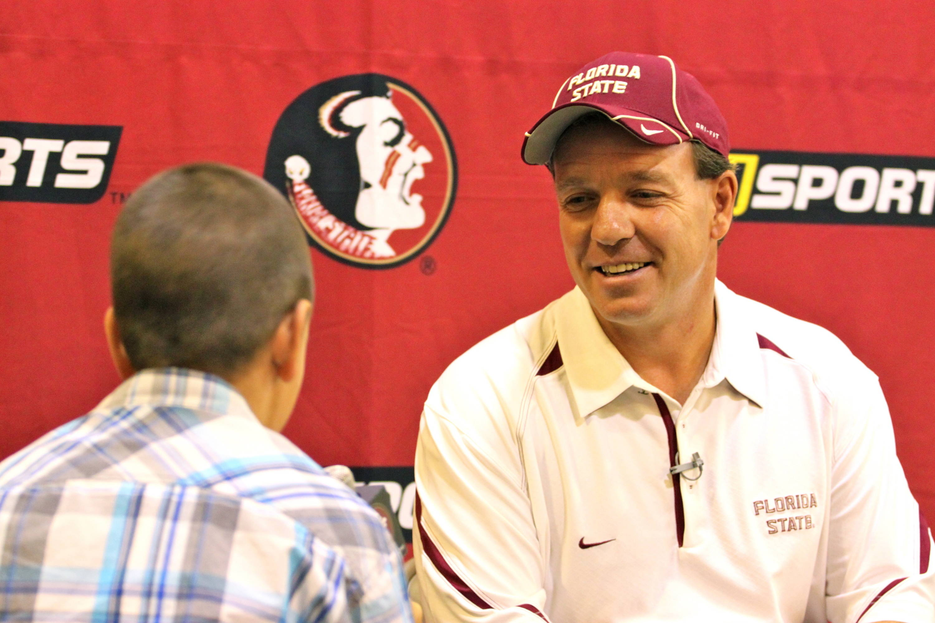 Jimbo Fisher and Jr. Nole reporter Blaine Thomas.