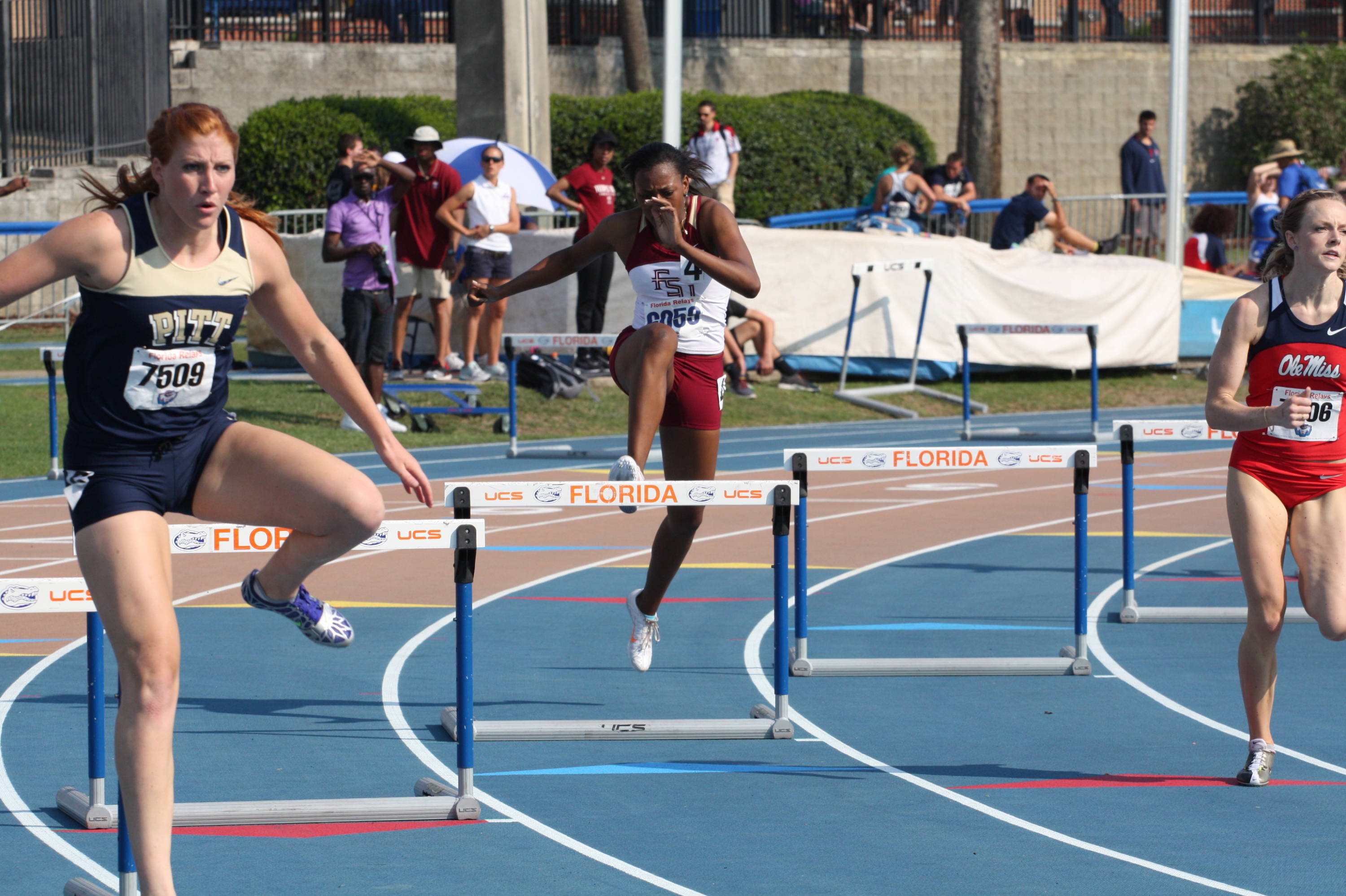 Marsha Ariol works her way into the turn in the 400-meter hurdles.
