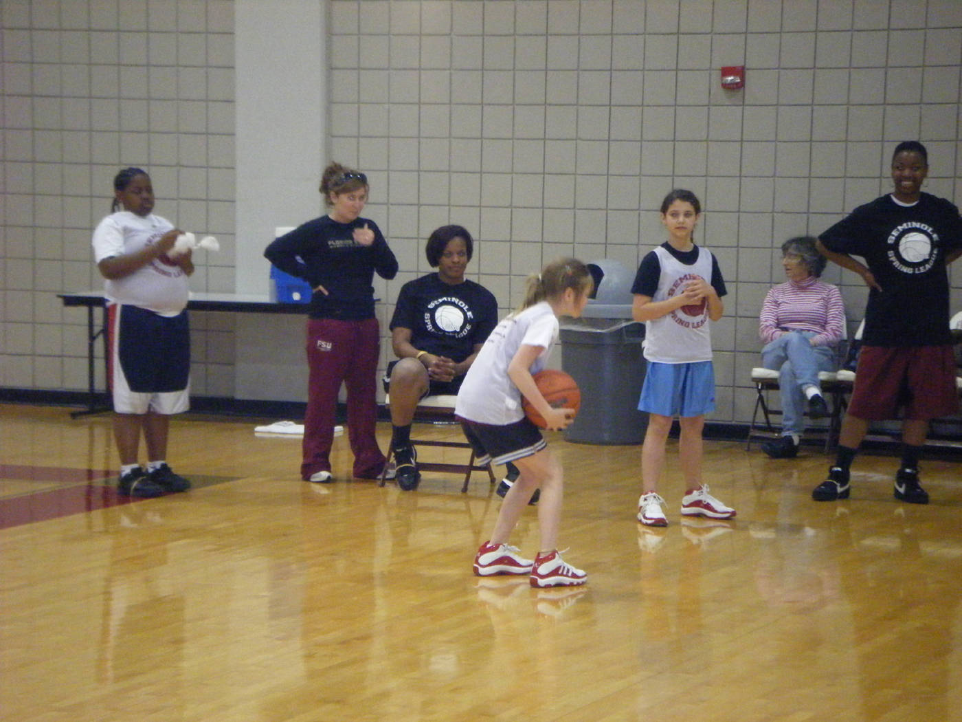 The girls showing their basketball skills to Cayla Moore and Angel Gray.