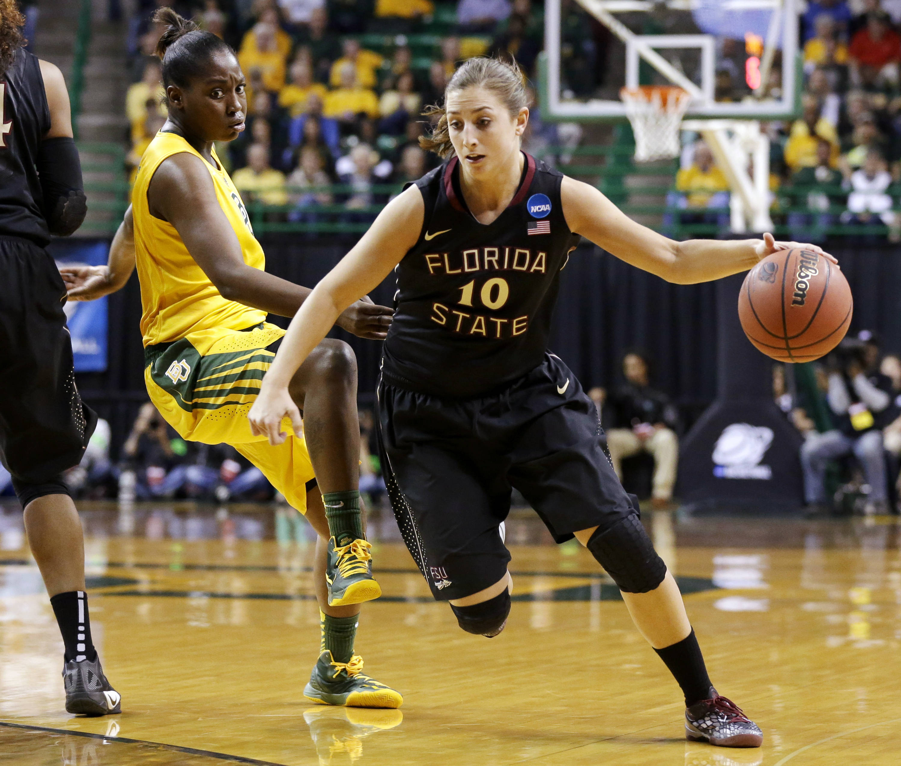 Florida State's Leonor Rodriguez (10) drives past Baylor's Kimetria Hayden, left, in the first half of a second-round game in the women's NCAA college basketball tournament, Tuesday, March 26, 2013, in Waco, Texas. (AP Photo/Tony Gutierrez)