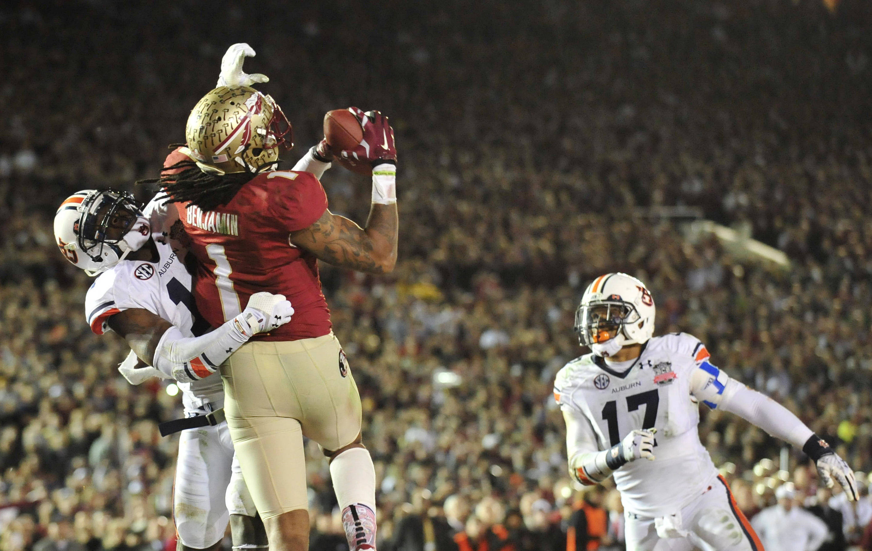Jan 6, 2014; Pasadena, CA, USA; Florida State Seminoles wide receiver Kelvin Benjamin (1) catches a touchdown pass ahead of Auburn Tigers cornerback Chris Davis (11) during the second half of the 2014 BCS National Championship game at the Rose Bowl.  Mandatory Credit: Gary A. Vasquez-USA TODAY Sports
