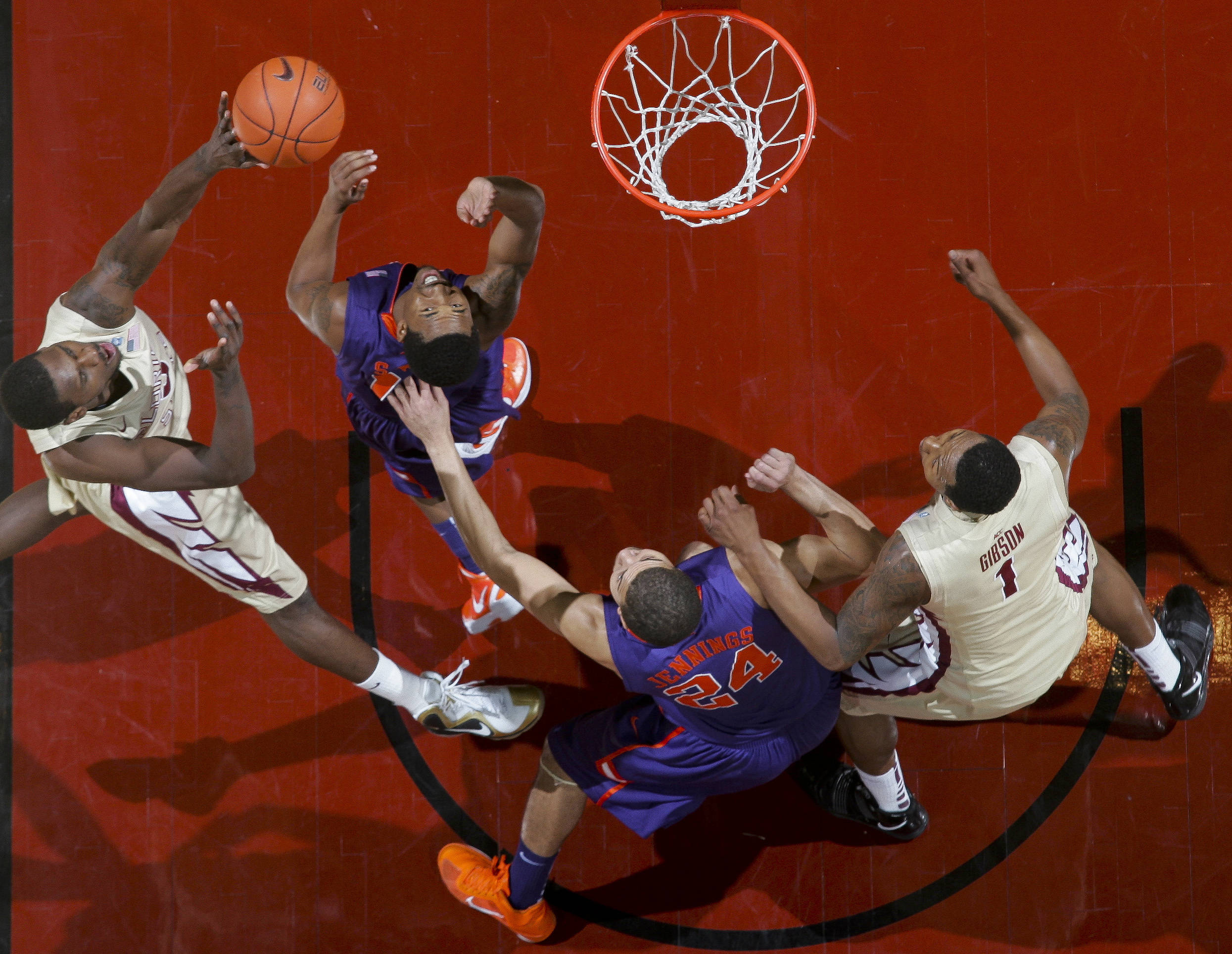 Florida State's Bernard James, left, goes for a layup in the first half . (AP Photo/Phil Sears)