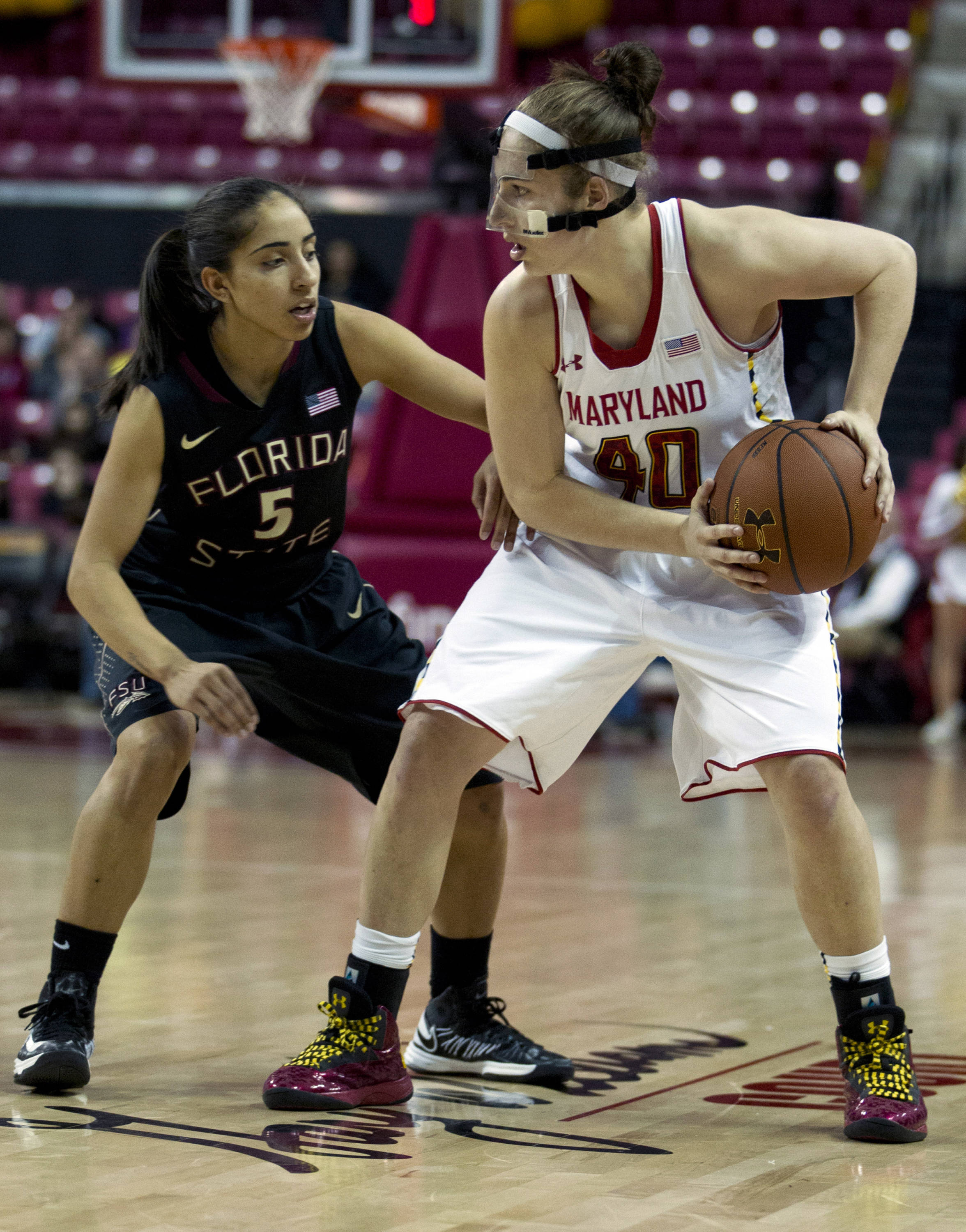Maryland's Katie Rutan (40) moves the ball against Florida State's Yashira Delgado (5) during the second half. (AP Photo/Jose Luis Magana)