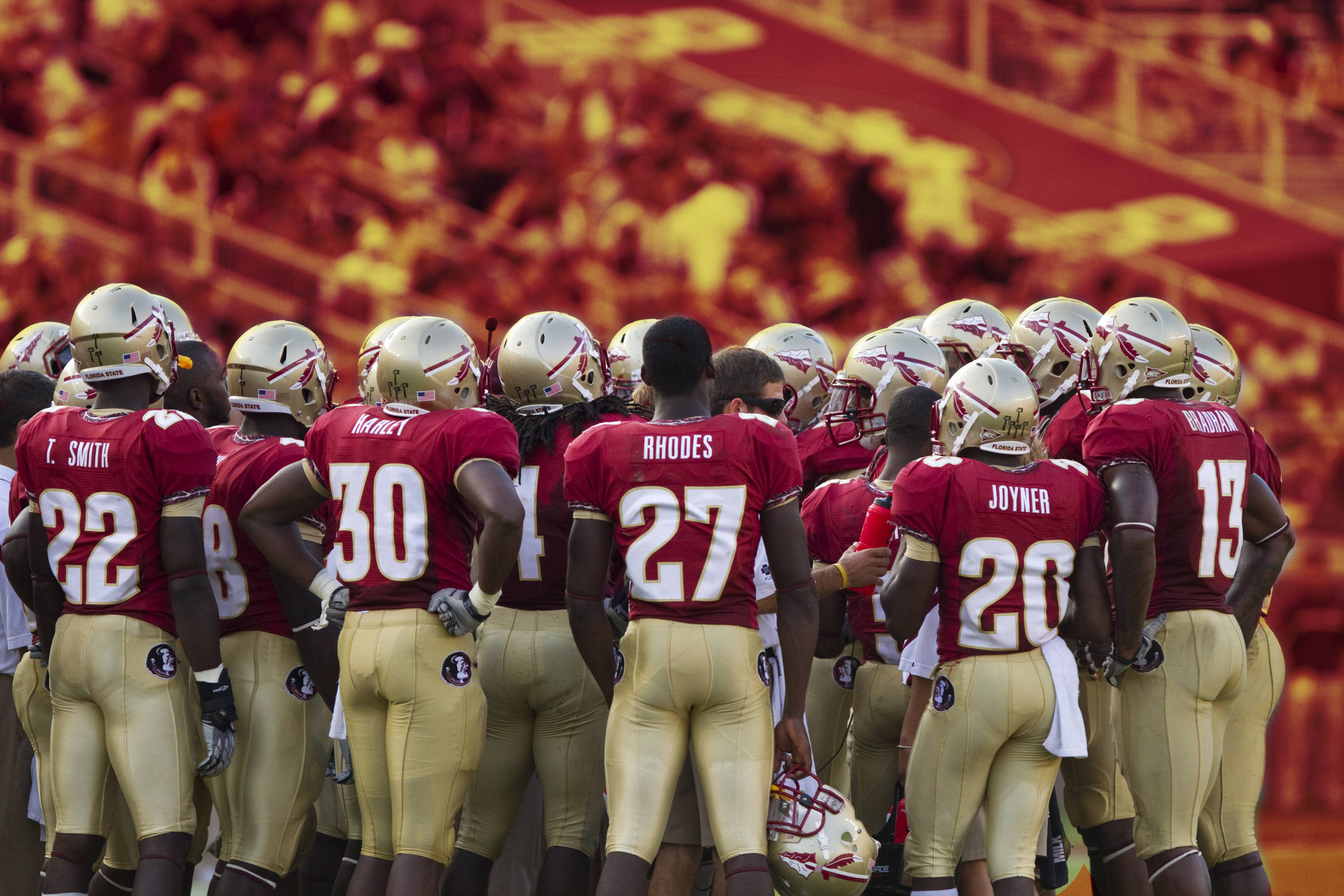 Jimbo Fisher talks with the team during a timeout in the second half of the game against BYU.  (photo illustration)