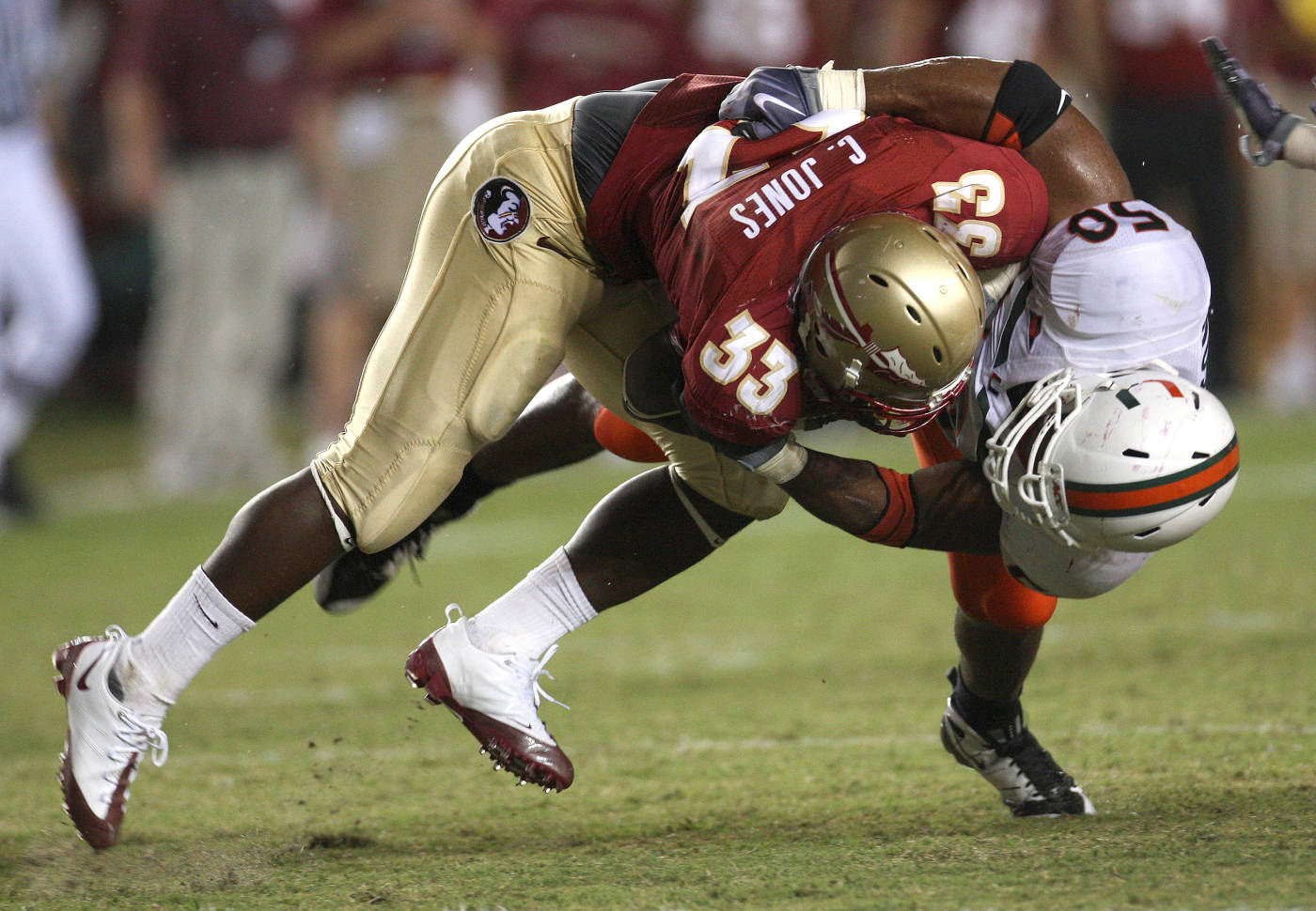 Florida State's Ty Jones is tackled by Miami's Darryl Sharpton on a third-quarter run during an NCAA college football game Monday, Sept. 7, 2009, in Tallahassee, Fla. (AP Photo/Phil Coale)