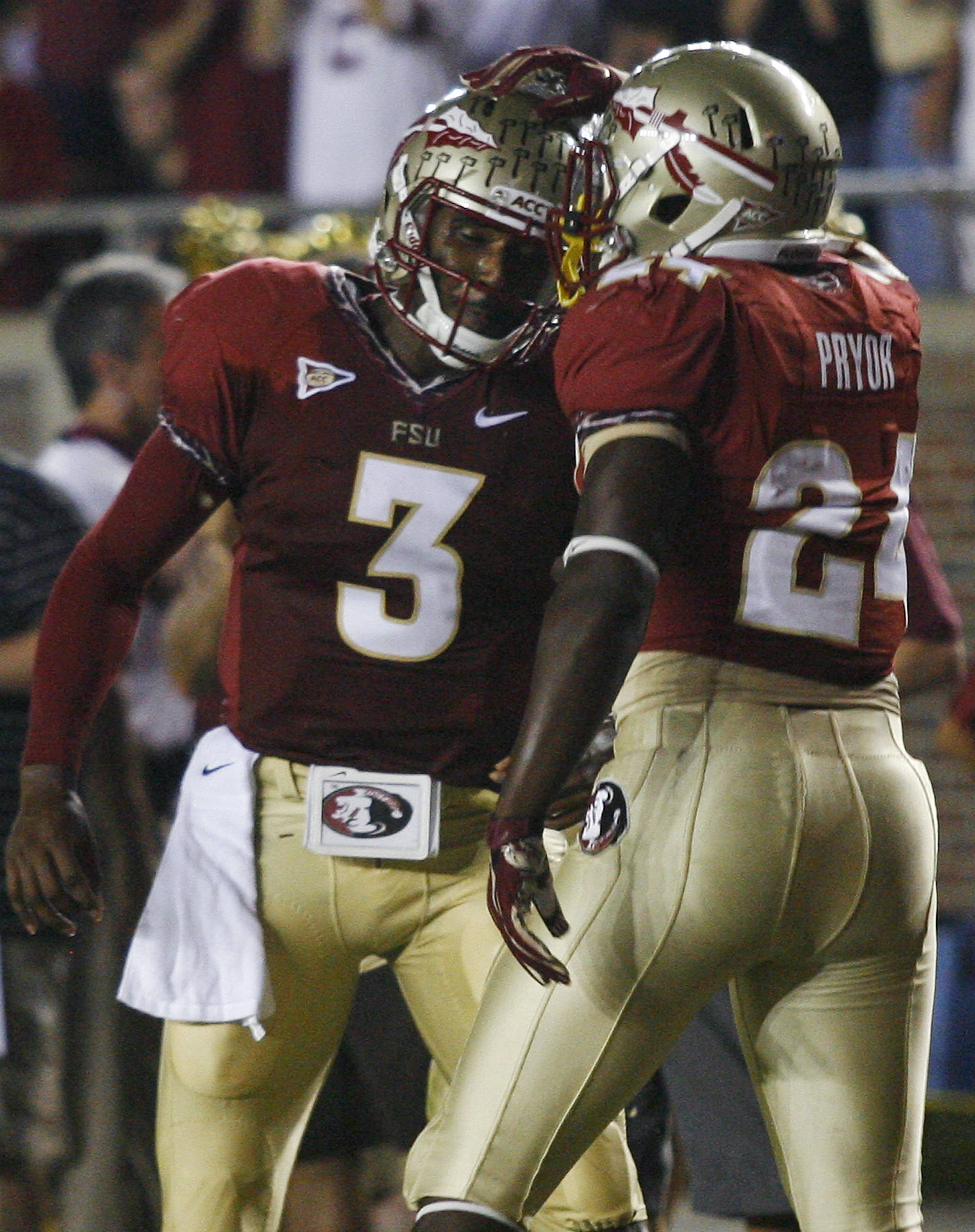 Florida State quarterback E.J. Manuel (3) and Florida State fullback Lonnie Pryor (24) celebrate Pryor's 13-yard touchdown. (AP Photo/Phil Sears)