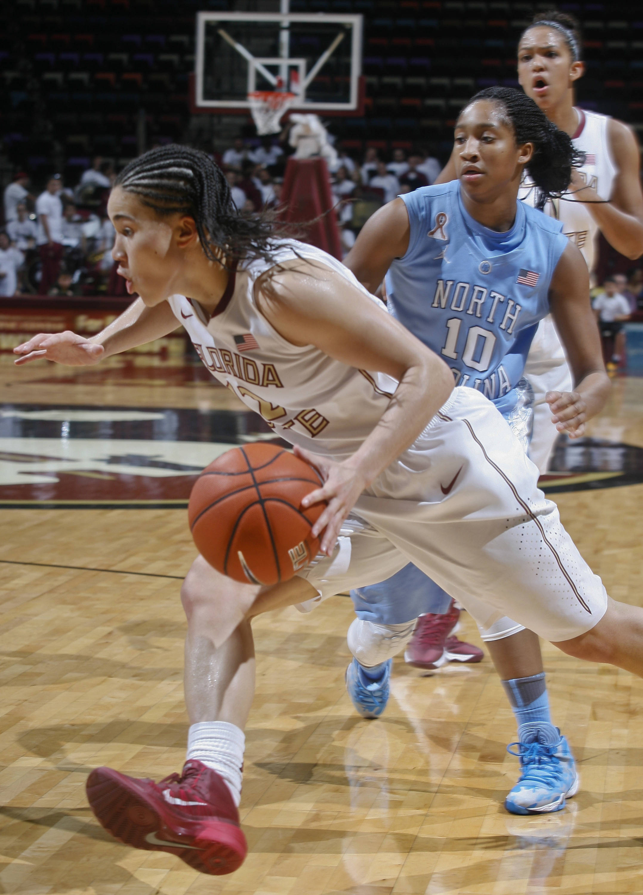 Jan 12, 2014; Tallahassee, FL, USA; Florida State Seminoles guard Brittany Brown (12) drives around North Carolina Tar Heels guard Danielle Butts (10) in the second half at the Tucker Center. The North Carolina Tar Heels defeated the Florida State Seminoles 65-61. Mandatory Credit: Phil Sears-USA TODAY Sports