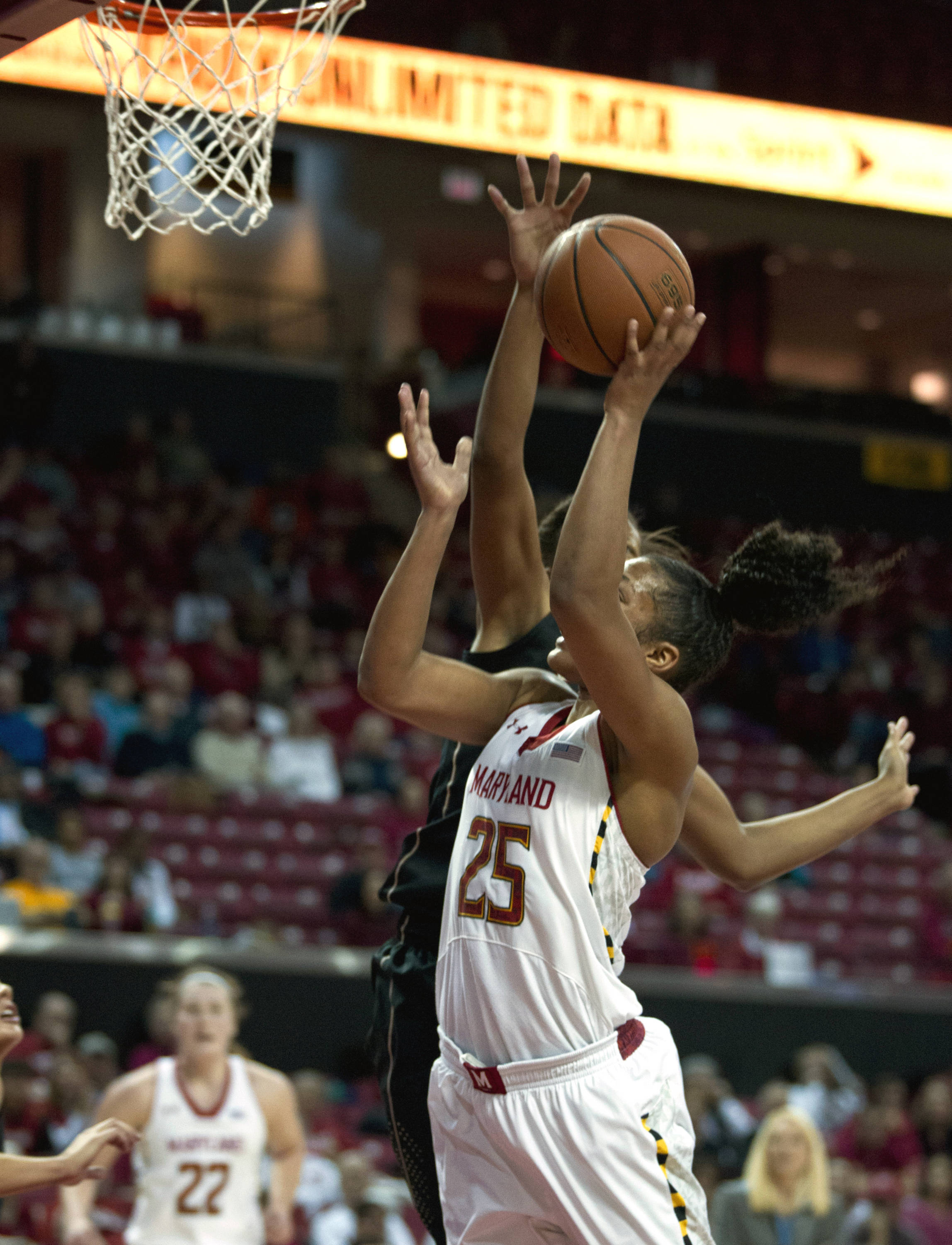 Maryland's Alyssa Thomas (25) shoots as Florida State's Chelsea Davis blocks during the second half. (AP Photo/Jose Luis Magana)