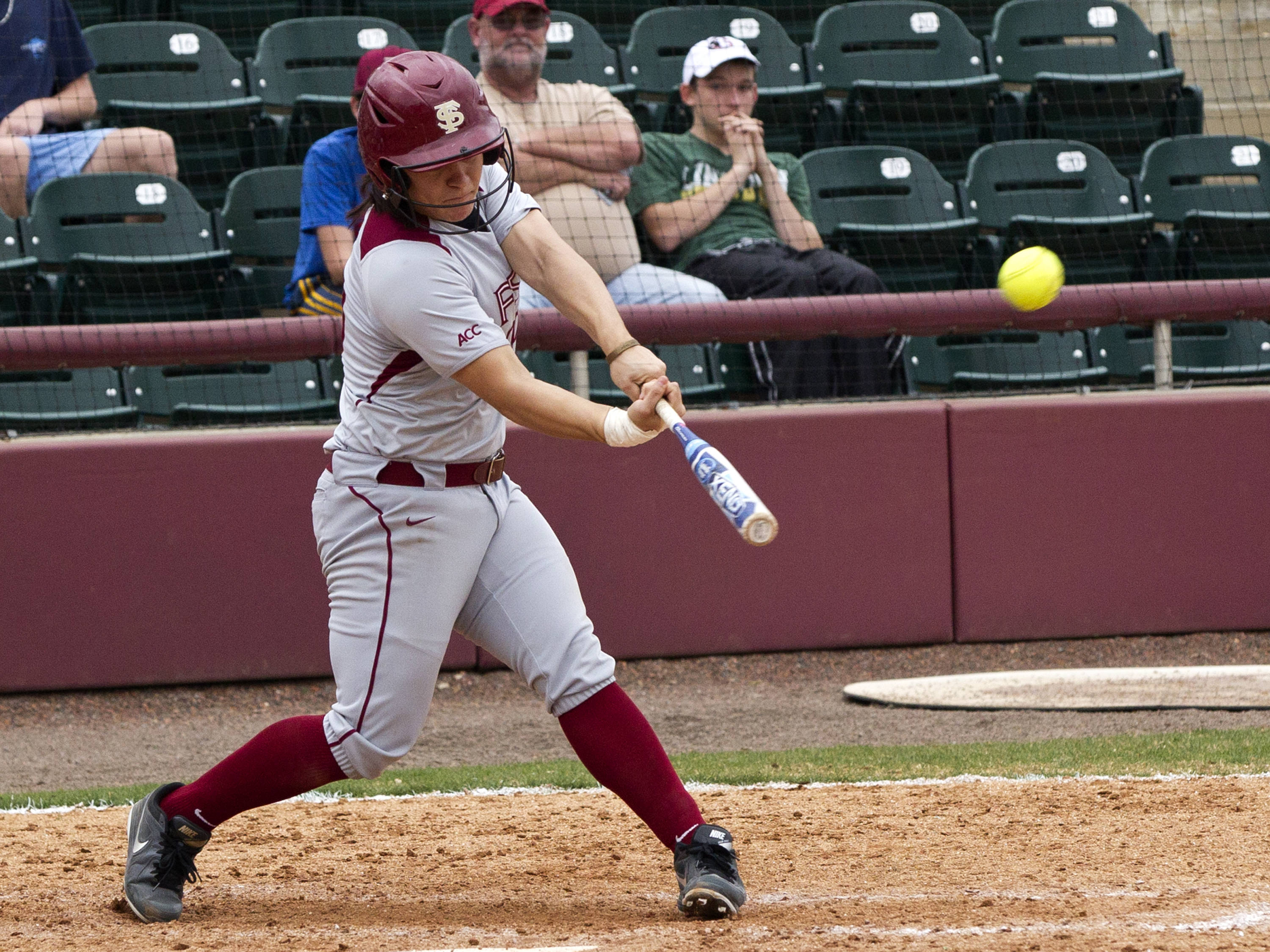 Celeste Gomez (00), launches her eventual game winning home run, FSU vs Minnesota, 03/17/13. (Photo by Steve Musco)