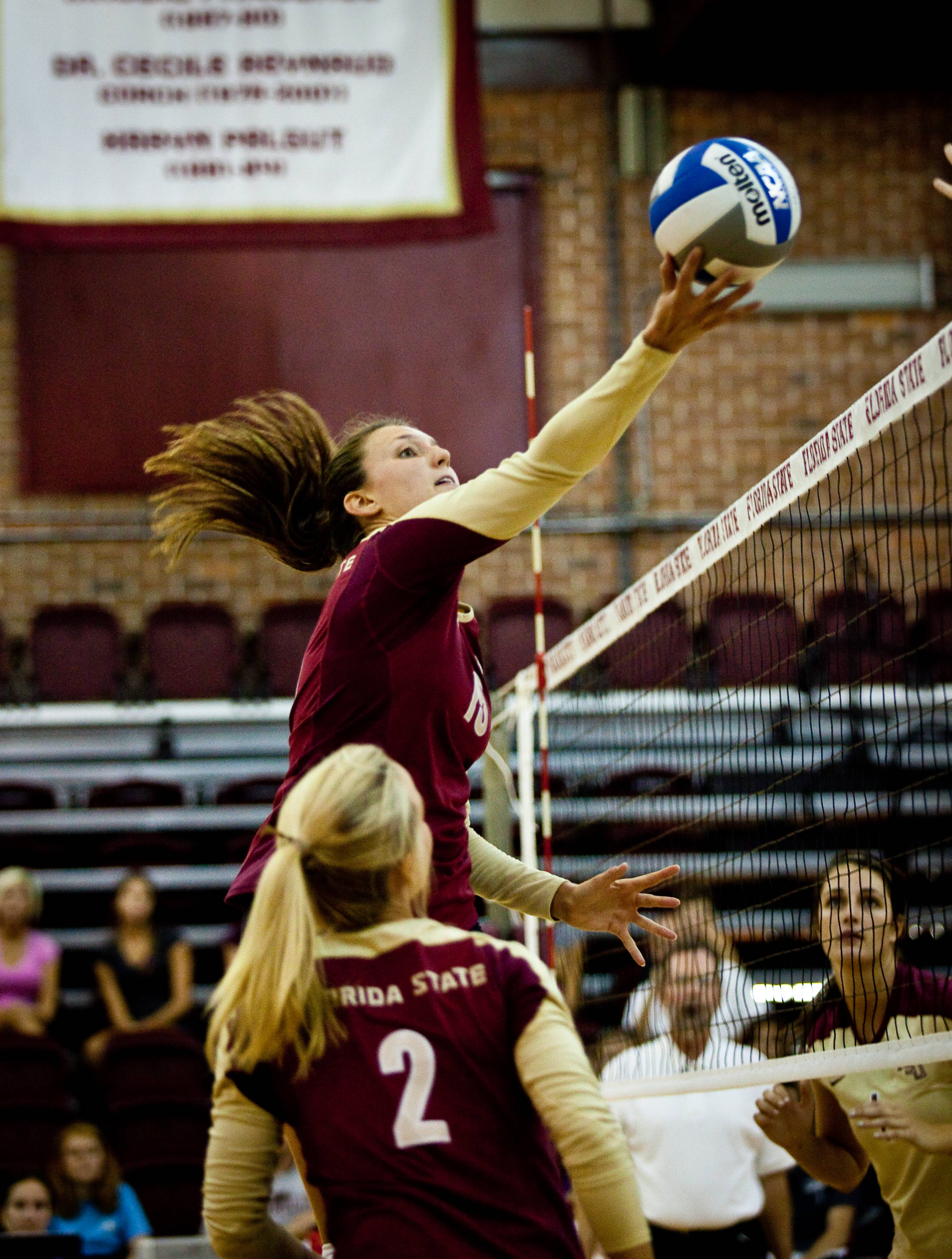 Amanda Saxton (15) tries to slip one over the net.