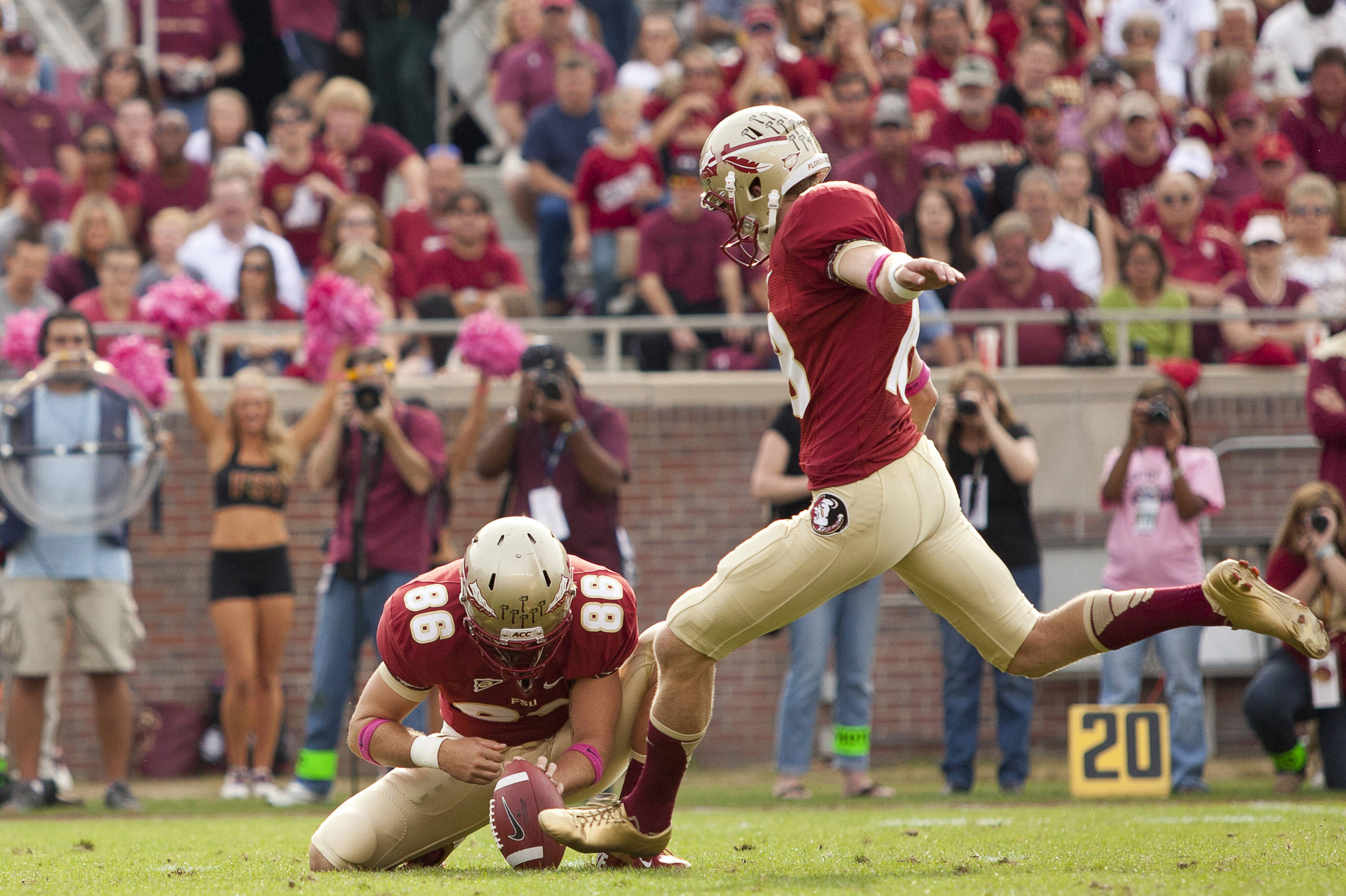Chris Revell (86) holds the ball for Dustin Hopkins (18) during FSU's 48-7 victory over Duke on October 27, 2012 in Tallahassee, Fla.