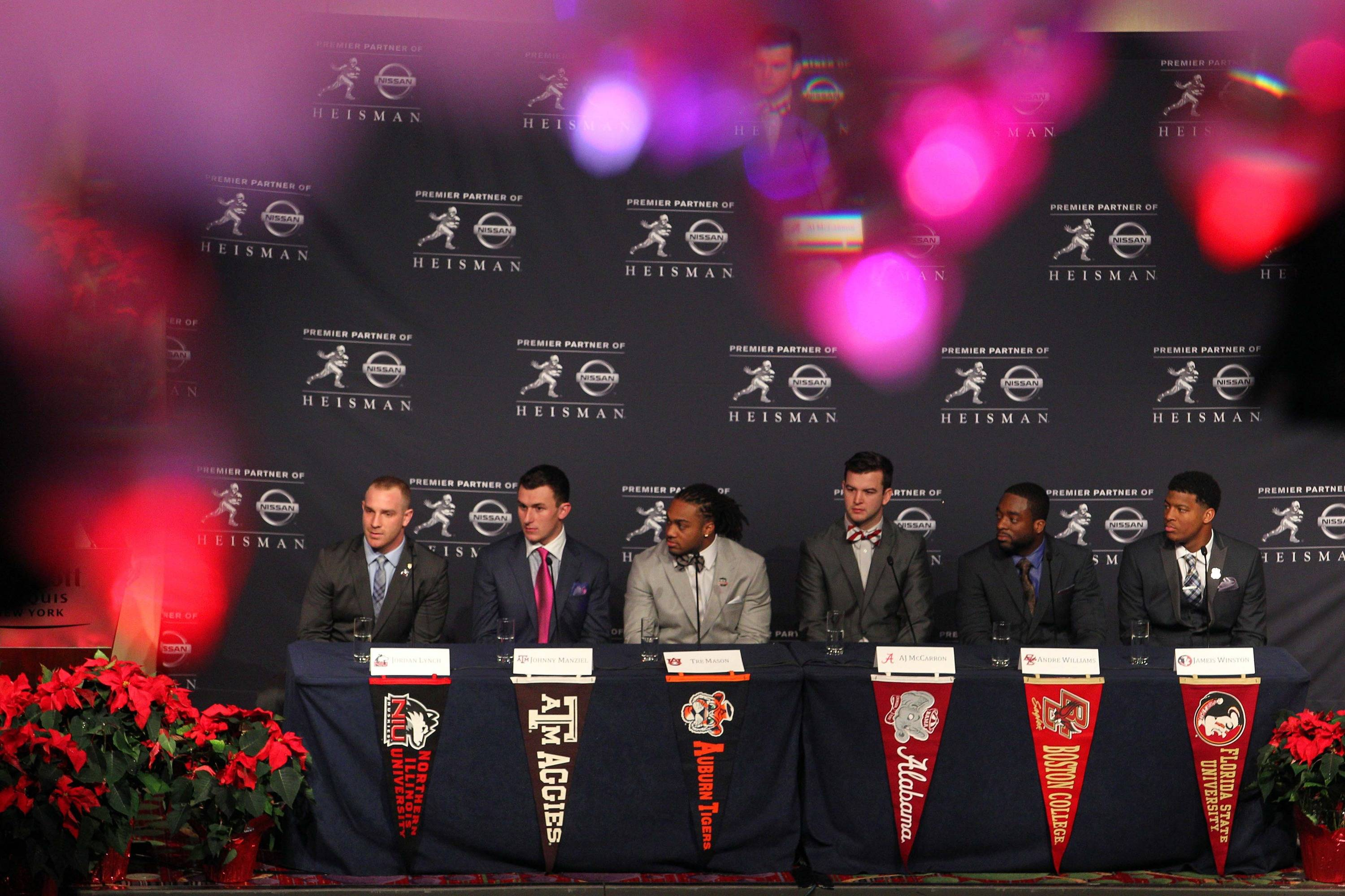 Dec 14, 2013; New York, NY, USA; From left Nothern Illinois Huskies quarterback Jordan Lynch and Texas A&M Aggies quarterback Johnny Manziel and Auburn Tigers running back Tre Mason and Alabama Crimson Tide quarterback AJ McCarron and Boston College Eagles running back Andre Williams and Florida State Seminoles quarterback Jameis Winston talk to the media during a press conference before the announcement of the 2013 Heisman Trophy winner at the New York Marriott Marquis Times Square in New York.