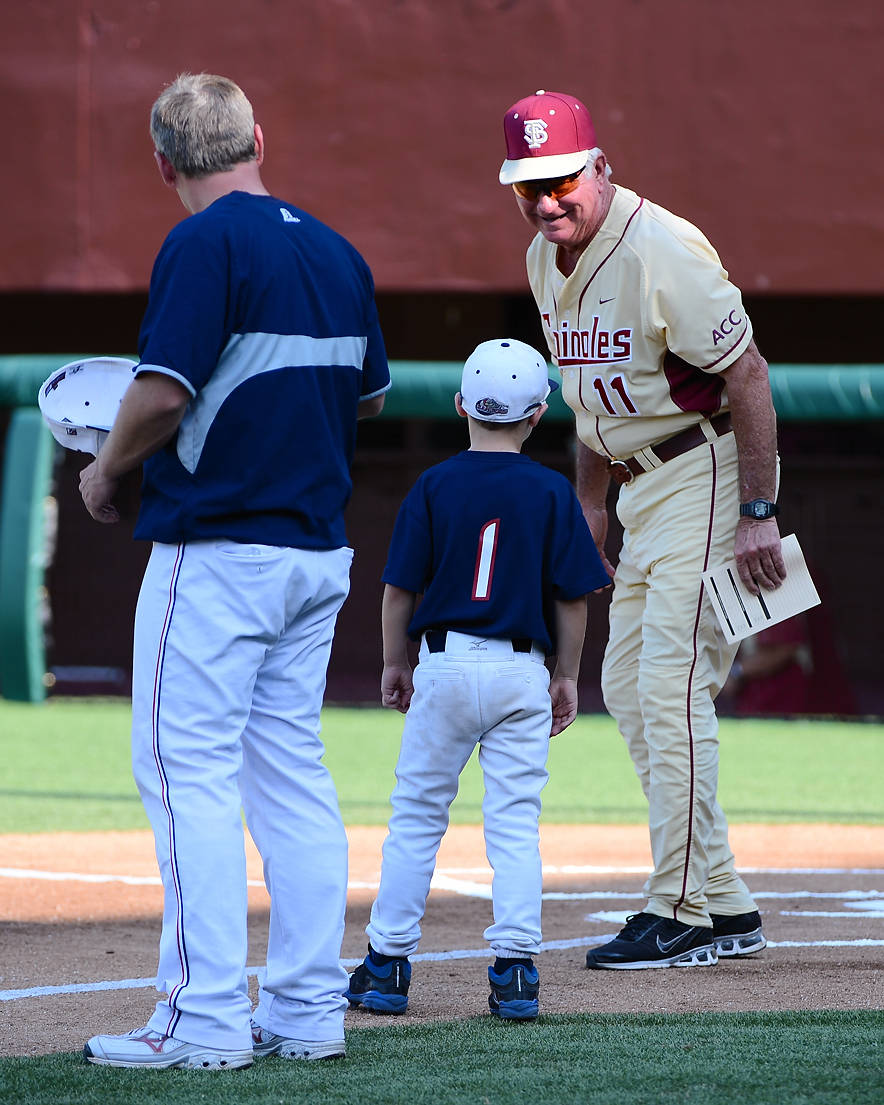 Head coach Mike Martin speaks with Samford head coach Casey Dunn and his son prior to the start of Sunday's game.