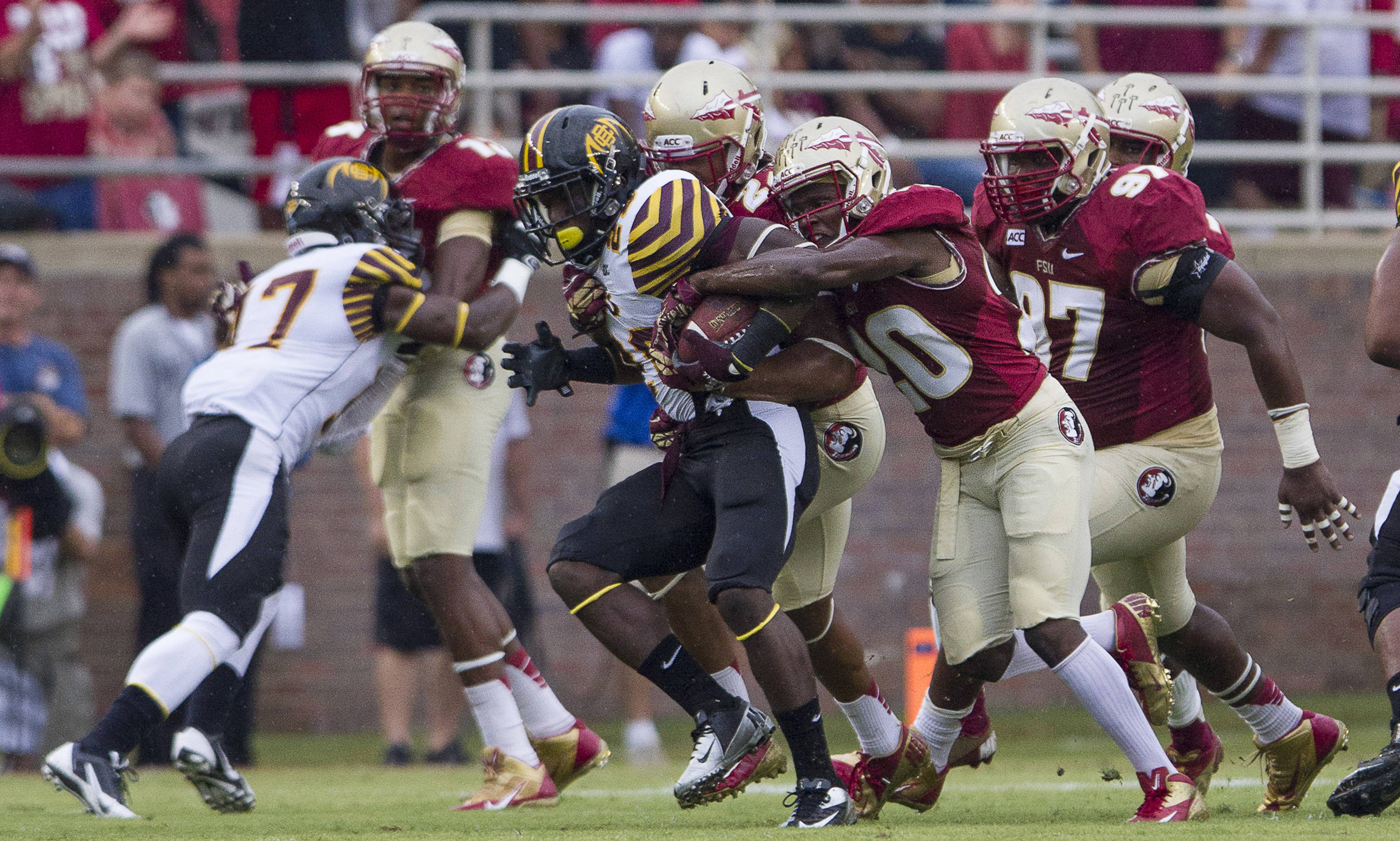 Lamarcus Joyner (20) attempts to strip the ball during FSU Football's 54-6 win over Bethune-Cookman on September 21, 2013 in Tallahassee, Fla
