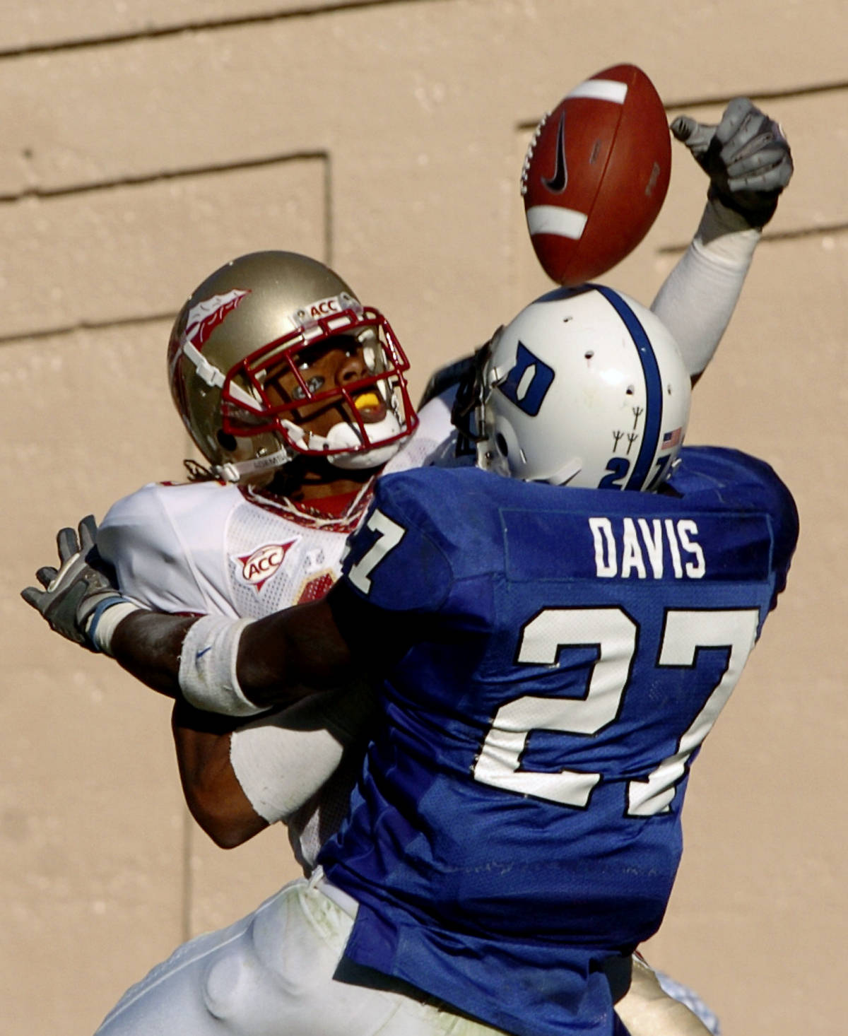 Duke's Chris Davis (27) intercepts a pass intended for Florida State's Preston Parker in the second half of a college football game in Durham, N.C., Saturday, Oct. 14, 2006. Florida State won 51-24. (AP Photo/Sara D. Davis)