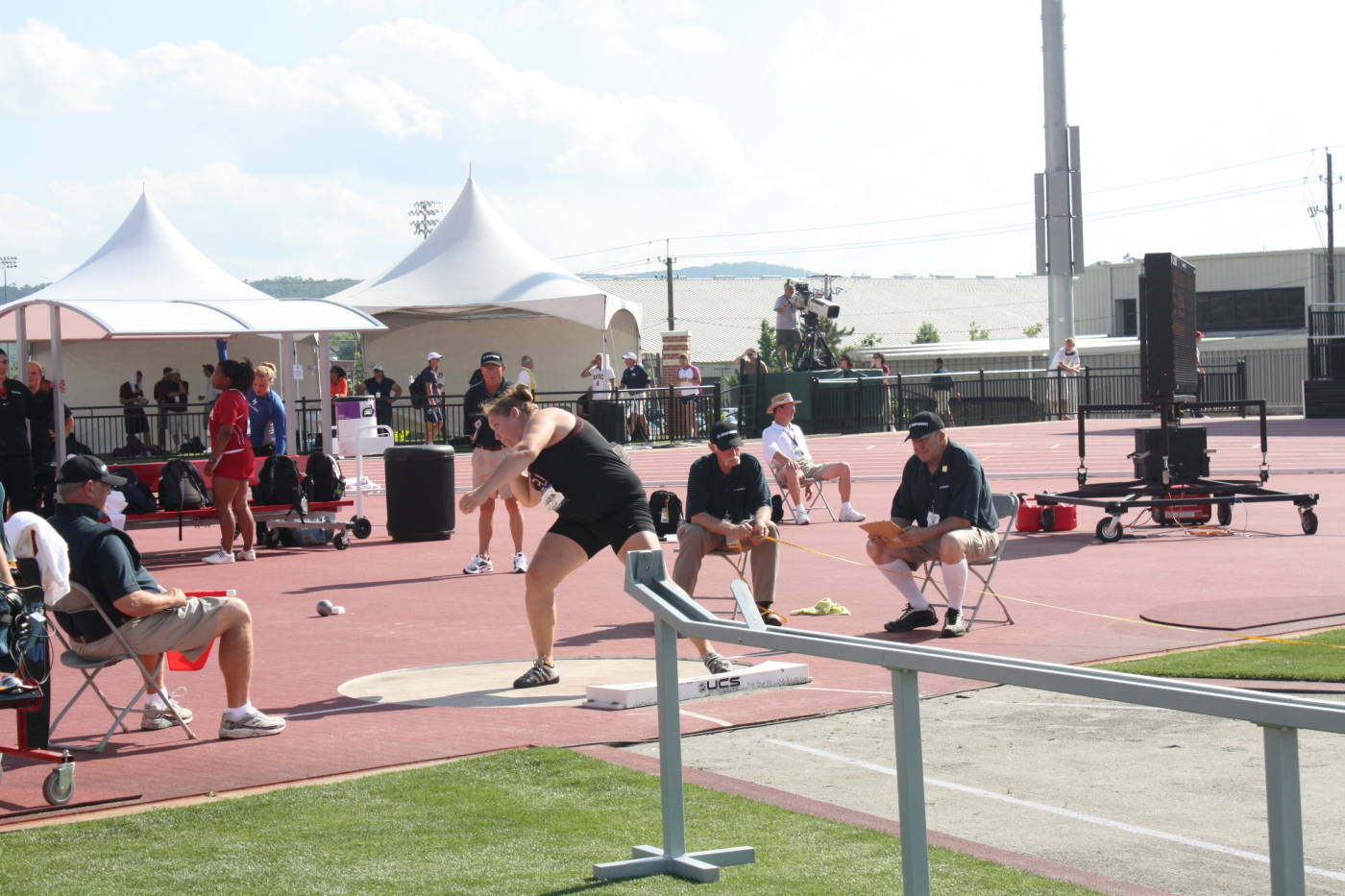 Allyn Laughlin scores in the women's shot put.