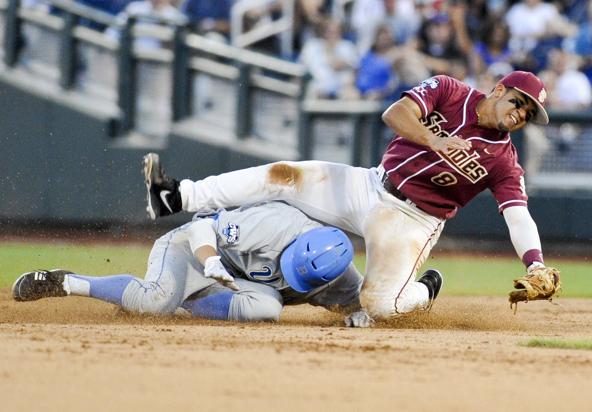 UCLA's Trevor Brown is out at second base as Florida State second baseman Devon Travis stumbles over him in the fifth inning. UCLA's Cody Regis reached first base on a fielder's choice in the play. (AP Photo/Eric Francis)