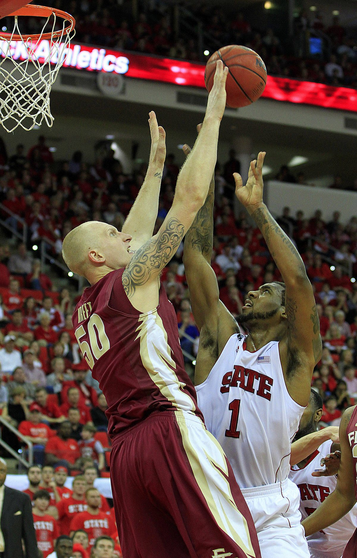 North Carolinas Richard Howell (1) tries to shoot the ball over Florida State's Jon Kreft (50) during the first half of an NCAA college basketball game in Raleigh, N.C., Saturday, Feb. 18, 2012. (AP Photo/Karl B DeBlaker)
