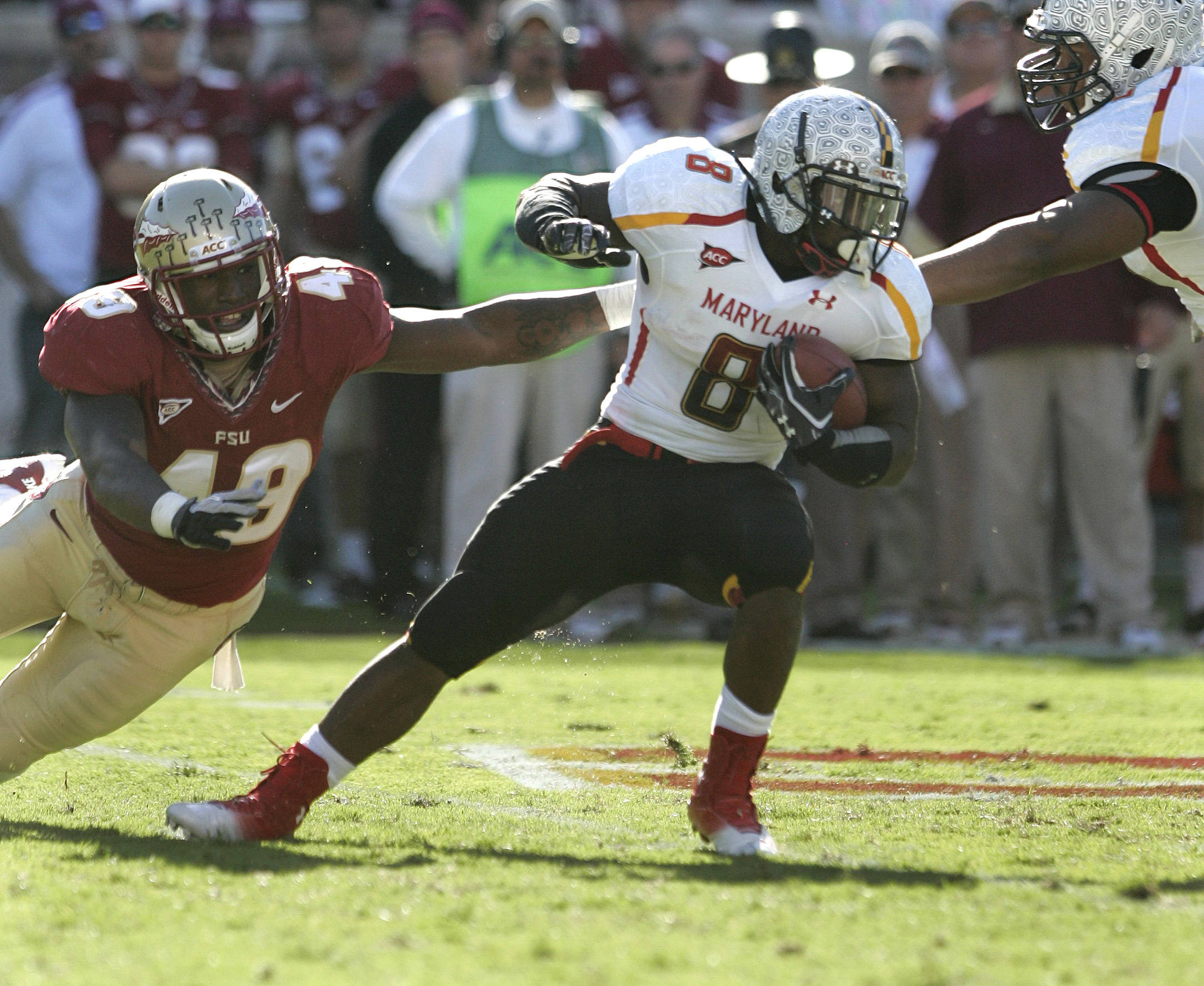 Florida State's Brandon Jenkins tries to bring down Maryland's Davin Meggett. (AP Photo/Steve Cannon)