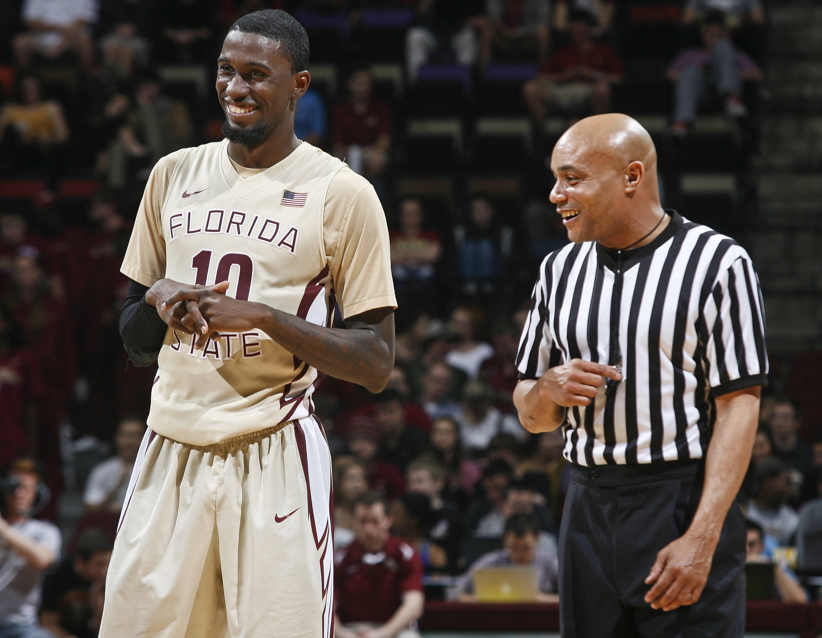 Feb 5, 2014; Tallahassee, FL, USA; Seminoles forward Okaro White (10) shares a laugh with referee Bill Covington, Jr. in the second half. Phil Sears-USA TODAY Sports