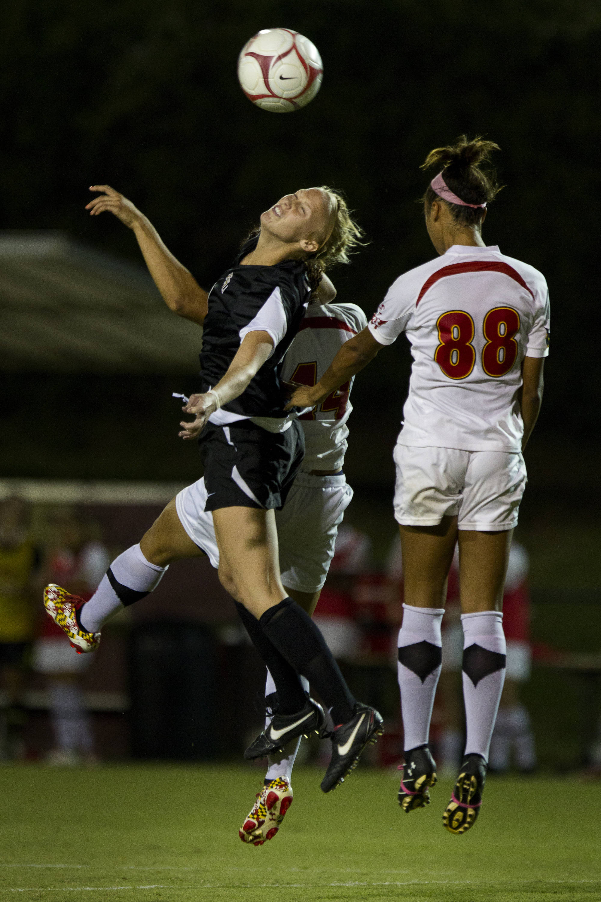 Ella Stephan (17) heads the ball during the game against Maryland on October 13, 2011.