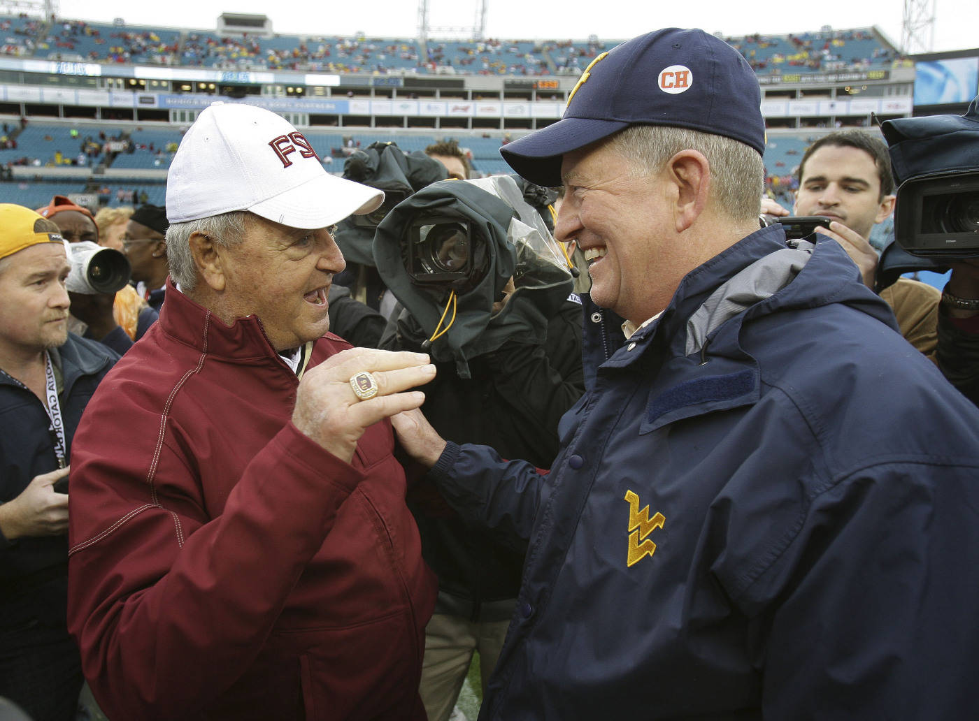 Florida State head coach, Bobby Bowden, left, meets with West Virginia head coach, Bill Stewart, prior to the kickoff of the Gator Bowl NCAA college football game, Friday, Jan. 1, 2010, in Jacksonville, Fla.(AP Photo/Phil Coale)
