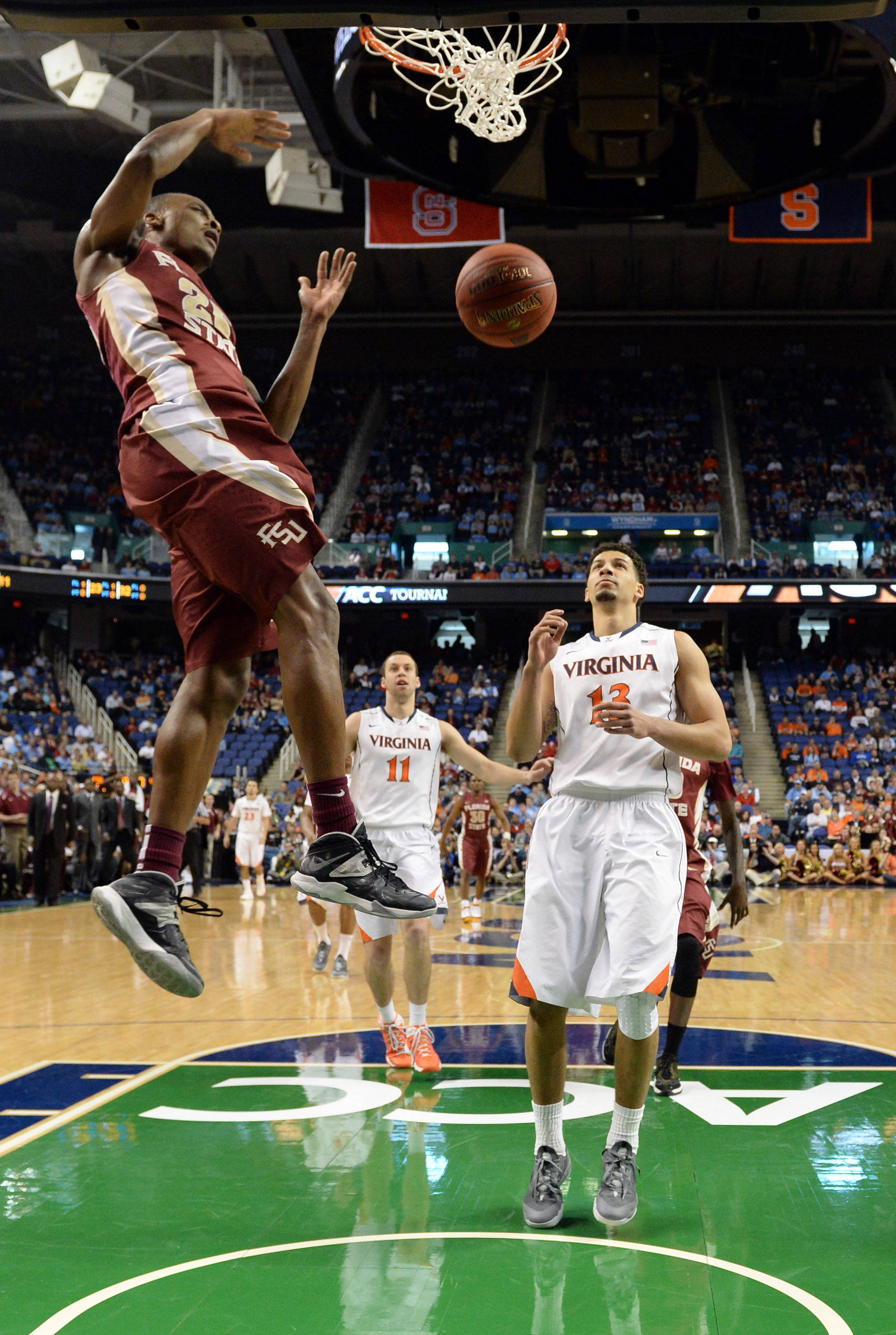 Mar 14, 2014; Greensboro, NC, USA;  Florida State Seminoles guard Aaron Thomas (25) goes up for a dunk against the Virginia Cavaliers in the quarterfinals of the ACC college basketball tournament at Greensboro Coliseum. Mandatory Credit: John David Mercer-USA TODAY Sports
