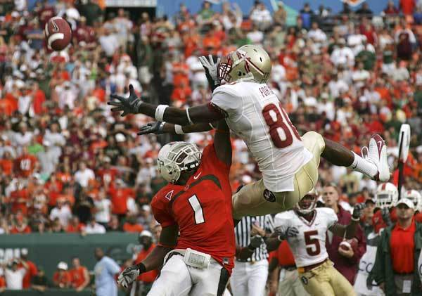 Florida State wide receiver Jarmon Forston (80) is unable to catch a pass as Miami defensive back Brandon Harris is charged with pass interference during the first half.