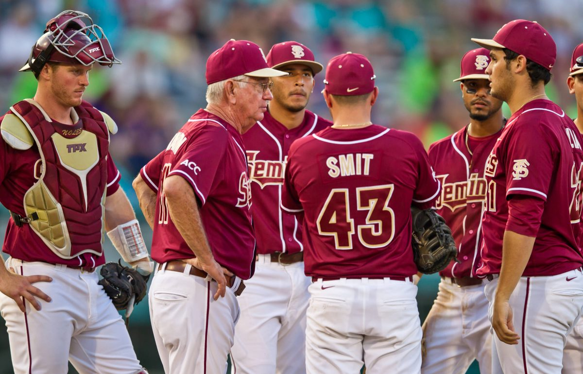 Head coach Mike Martin meets at the mound with the Seminoles