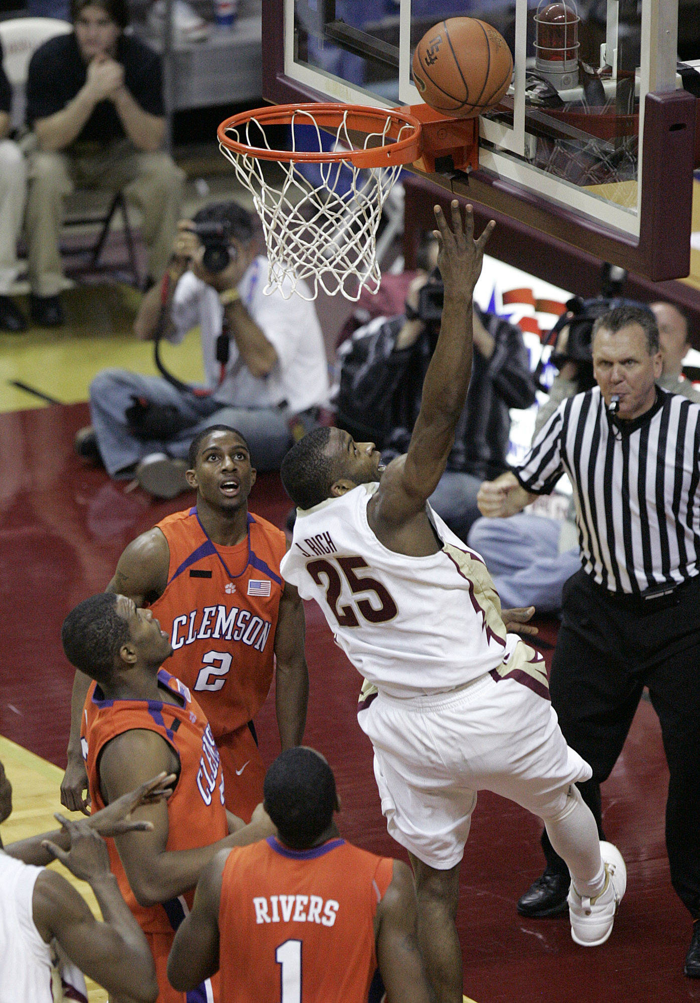 Florida State's Jason Rich scores after being fouled by Clemson's Trevor Booker, middle at left, during the second half of a basketball game Tuesday, Feb. 19, 2008, in Tallahassee, Fla. Also defending for Clemson are K.C. Rivers (1) and Demontez Stitt (2). Florida State won 64-55. (AP Photo/Steve Cannon)