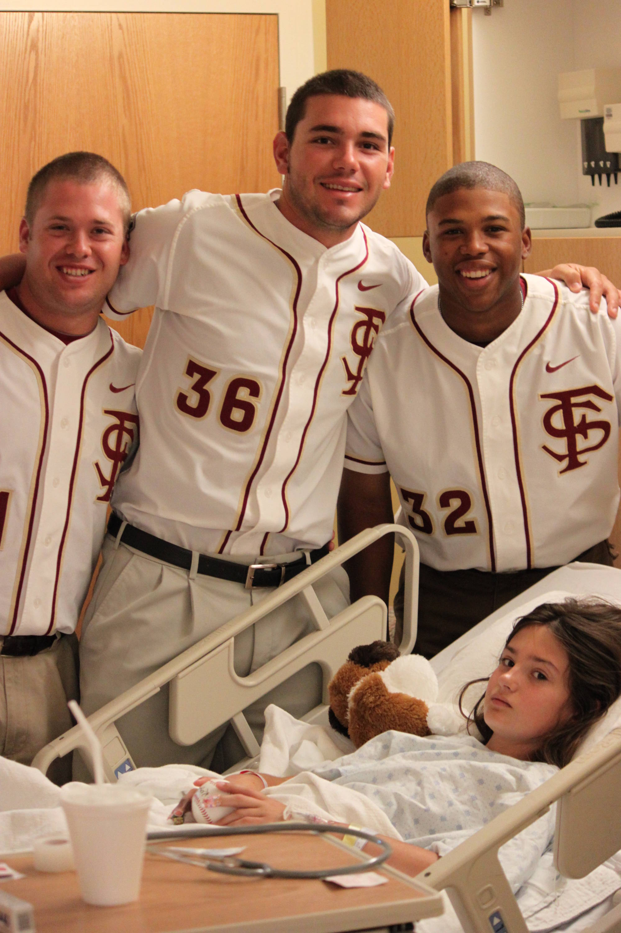 Drew Strouse, Robby Scott and Sherman Johnson on a visit to the Children's Hospital in Omaha