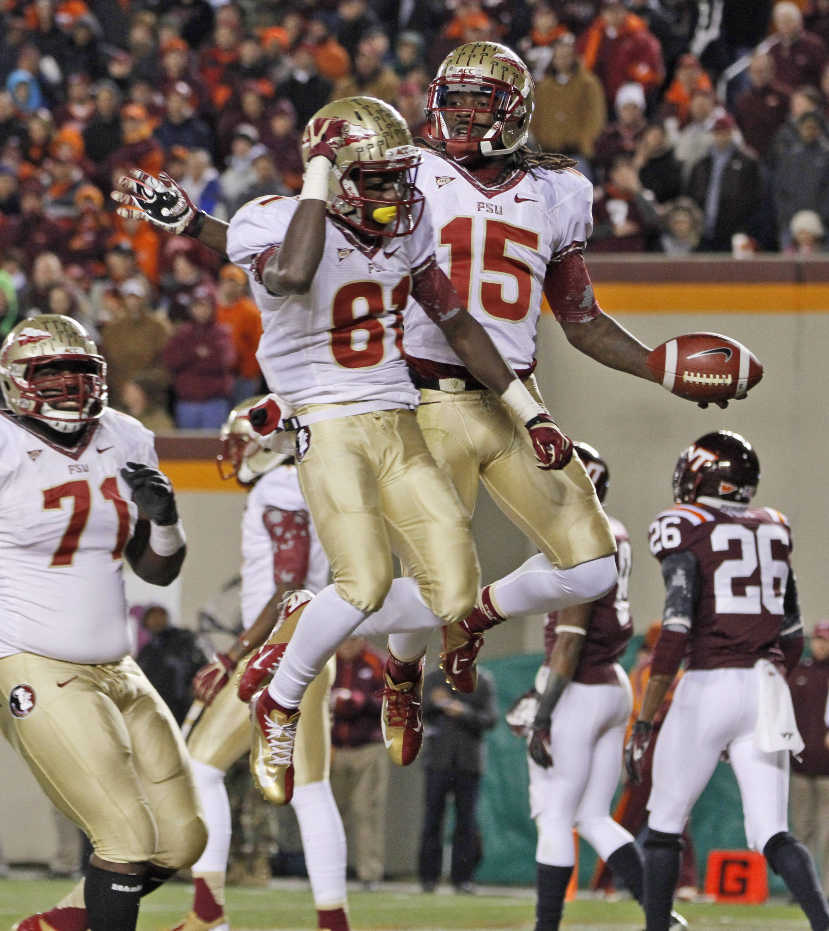 Florida State wide receiver Greg Dent (15) celebrates a touchdown with teammate Rashad Greene (80). (AP Photo/Steve Helber)