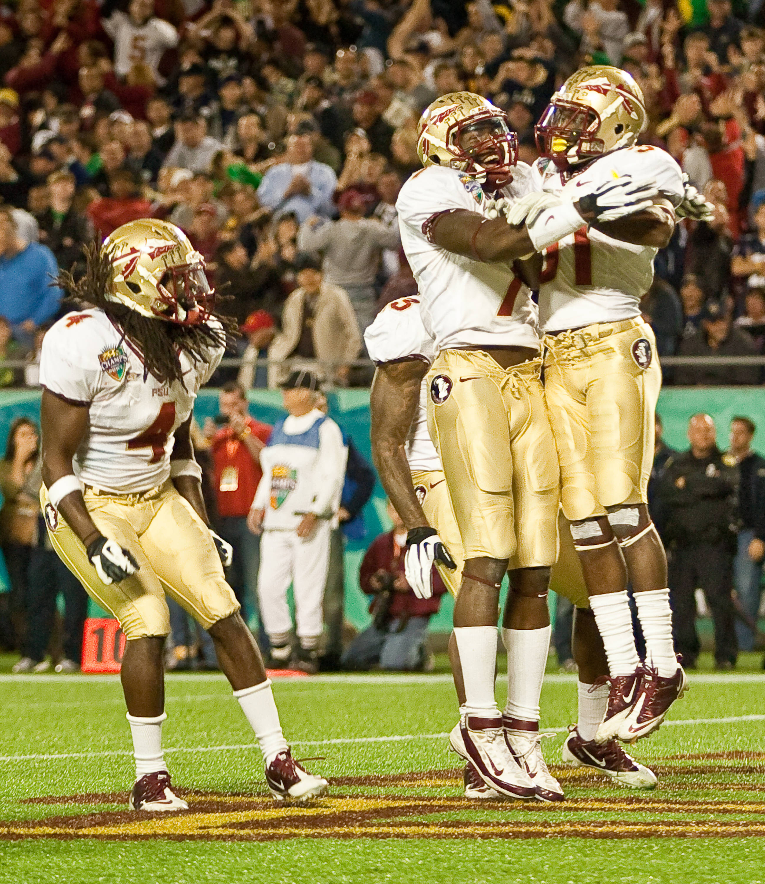 The Seminoles celebrate Terrance Brooks game clinching interception.