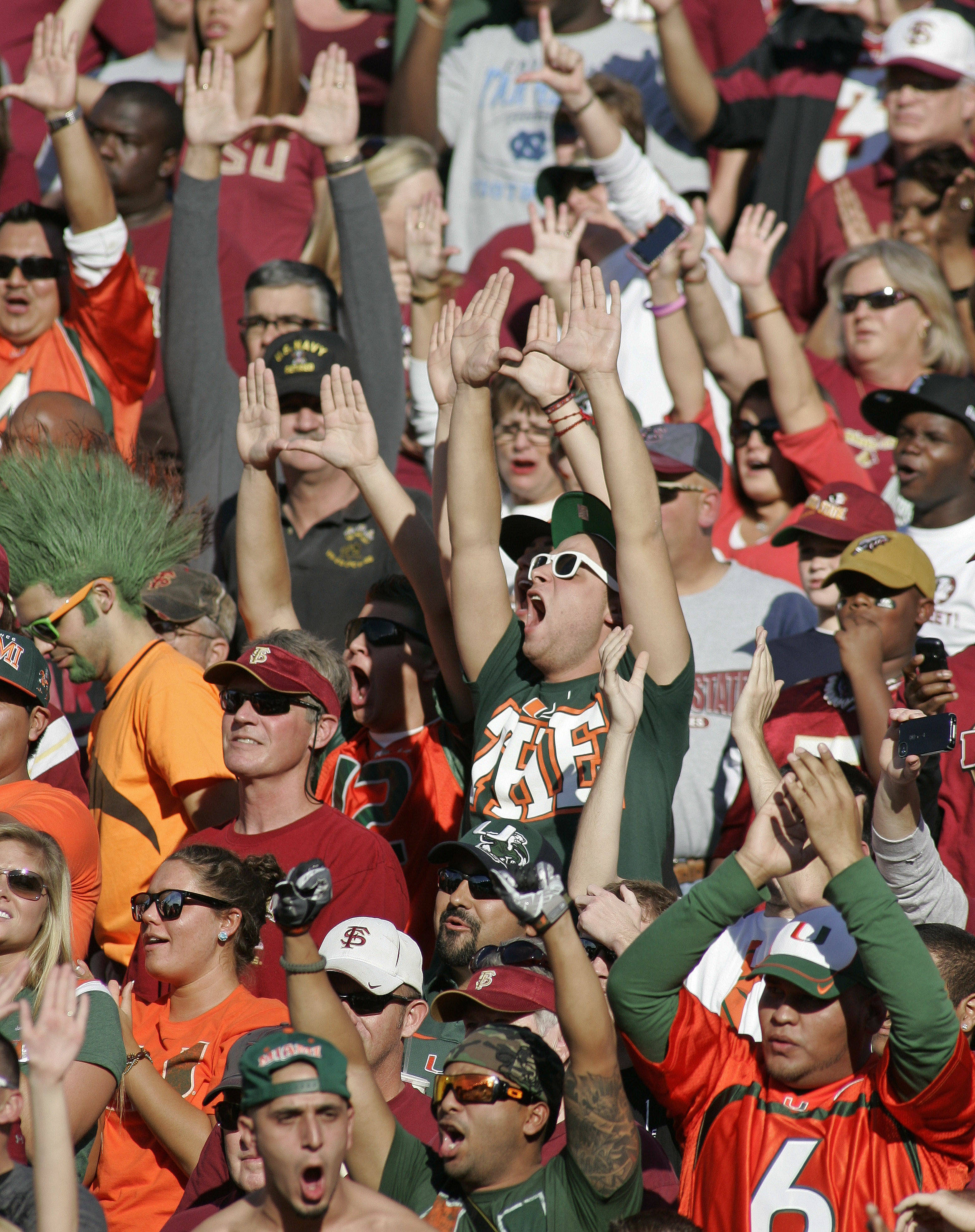 Miami fans cheer during the first quarter of an NCAA college football game against Florida State on Saturday, Nov. 12, 2011 in Tallahassee, Fla. (AP Photo/Phil Sears)