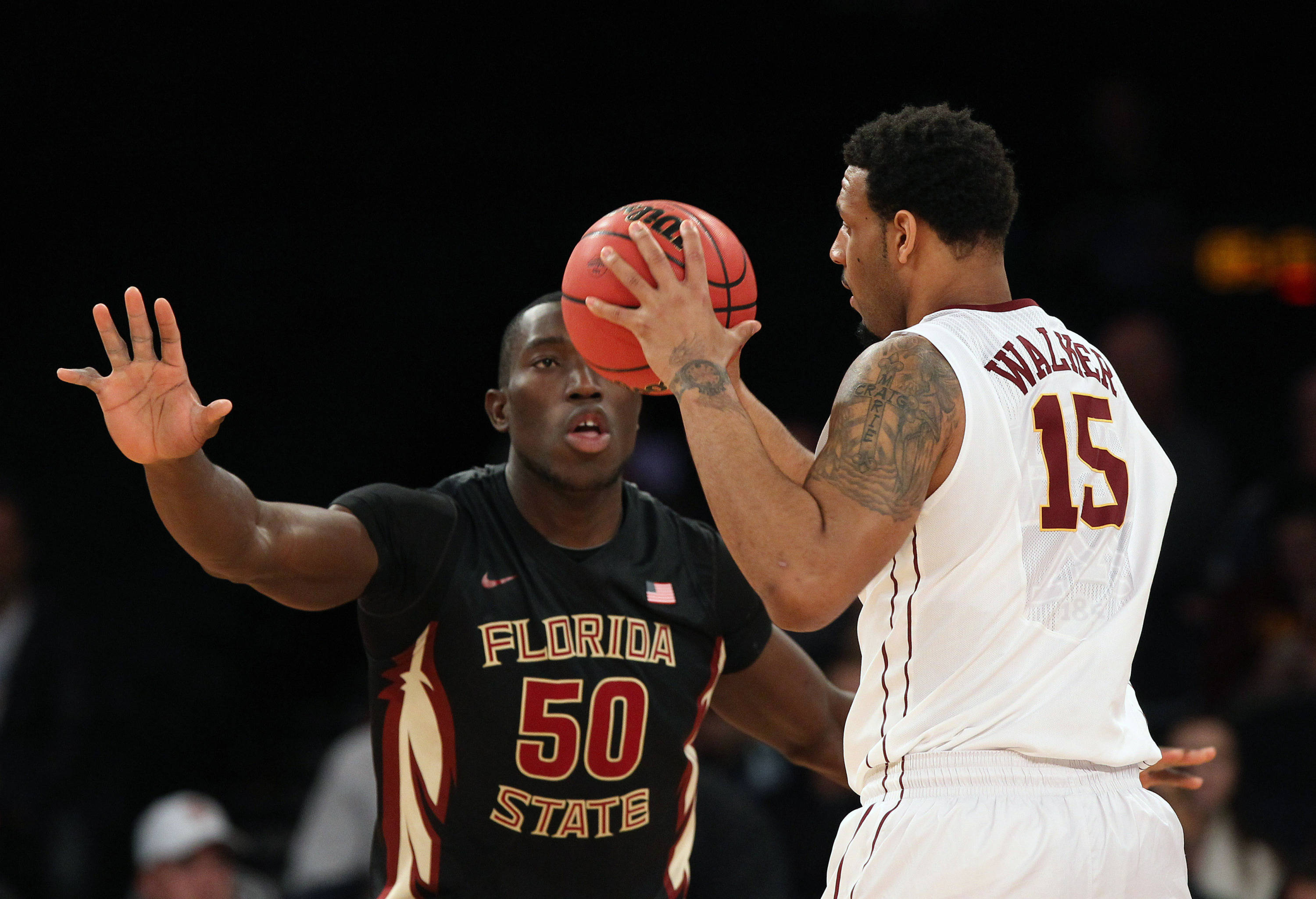 Apr 1, 2014; New York, NY, USA; Minnesota Golden Gophers forward Maurice Walker (15) is defended by Florida State Seminoles center Michael Ojo (50) during the first half at Madison Square Garden. Mandatory Credit: Adam Hunger-USA TODAY Sports