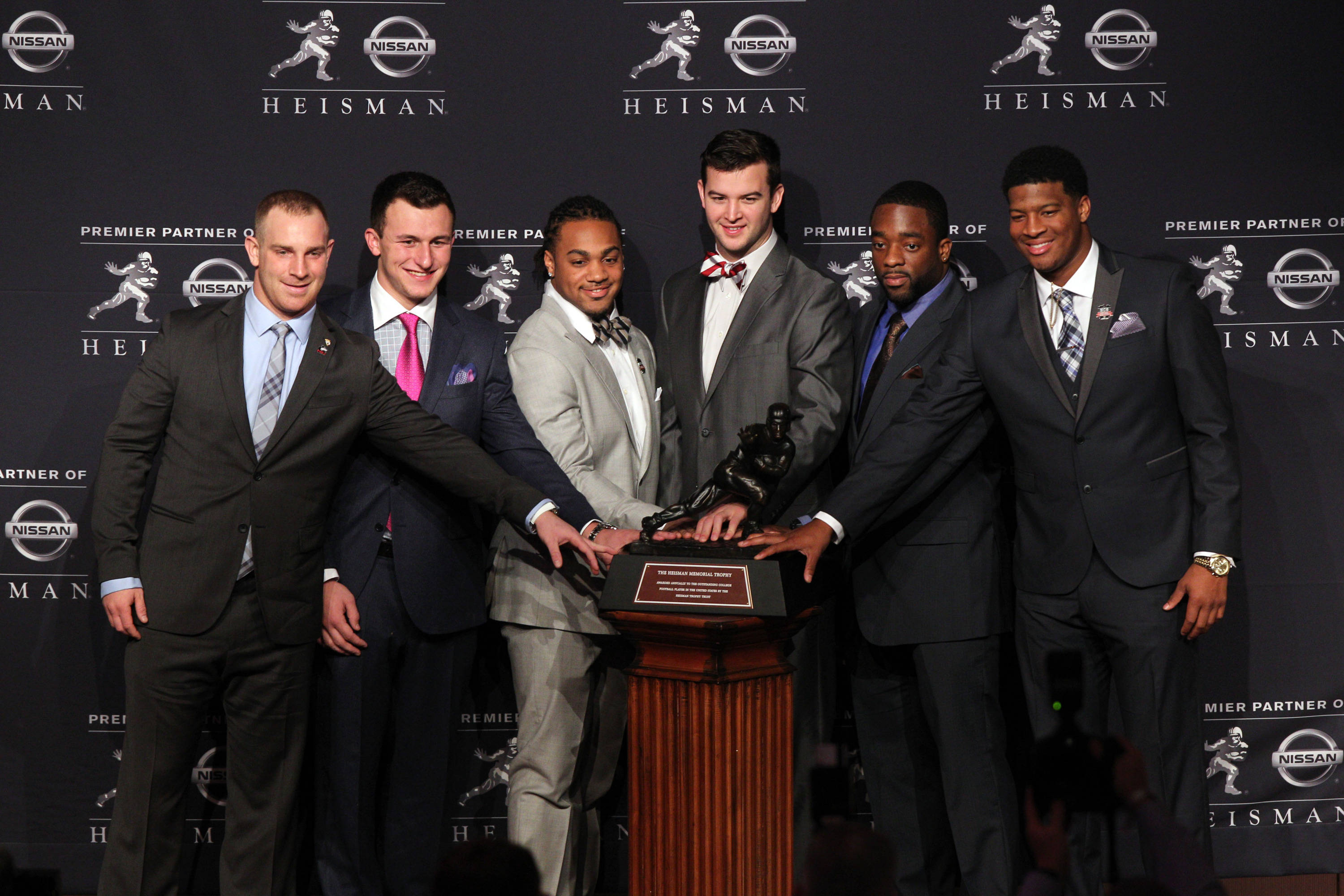 Dec 14, 2013; New York, NY, USA; (From left to right) Nothern Illinois Huskies quarterback Jordan Lynch, and Texas A&M Aggies quarterback Johnny Manziel, and Auburn Tigers running back Tre Mason, and Alabama Crimson Tide quarterback AJ McCarron, and Boston College Eagles running back Andre Williams, and Florida State Seminoles quarterback Jameis Winston pose for a photo during a press conference before the announcement of the 2013 Heisman Trophy winner at the New York Marriott Marquis Times