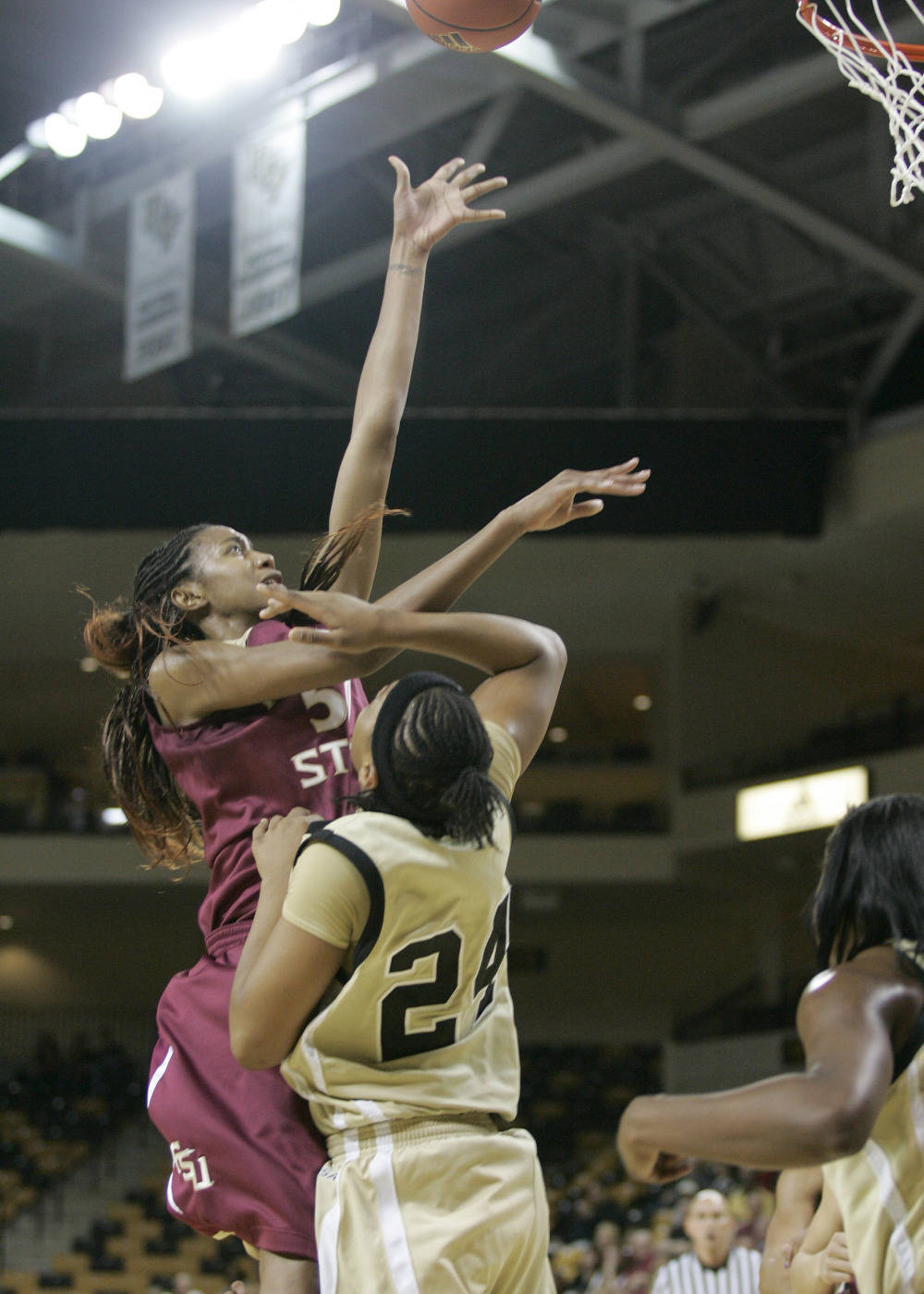 Central Florida forward Emma Cannon (24) gets a block against Florida State forward Jacinta Monroe (50) during the first half. (Photo/Reinhold Matay)