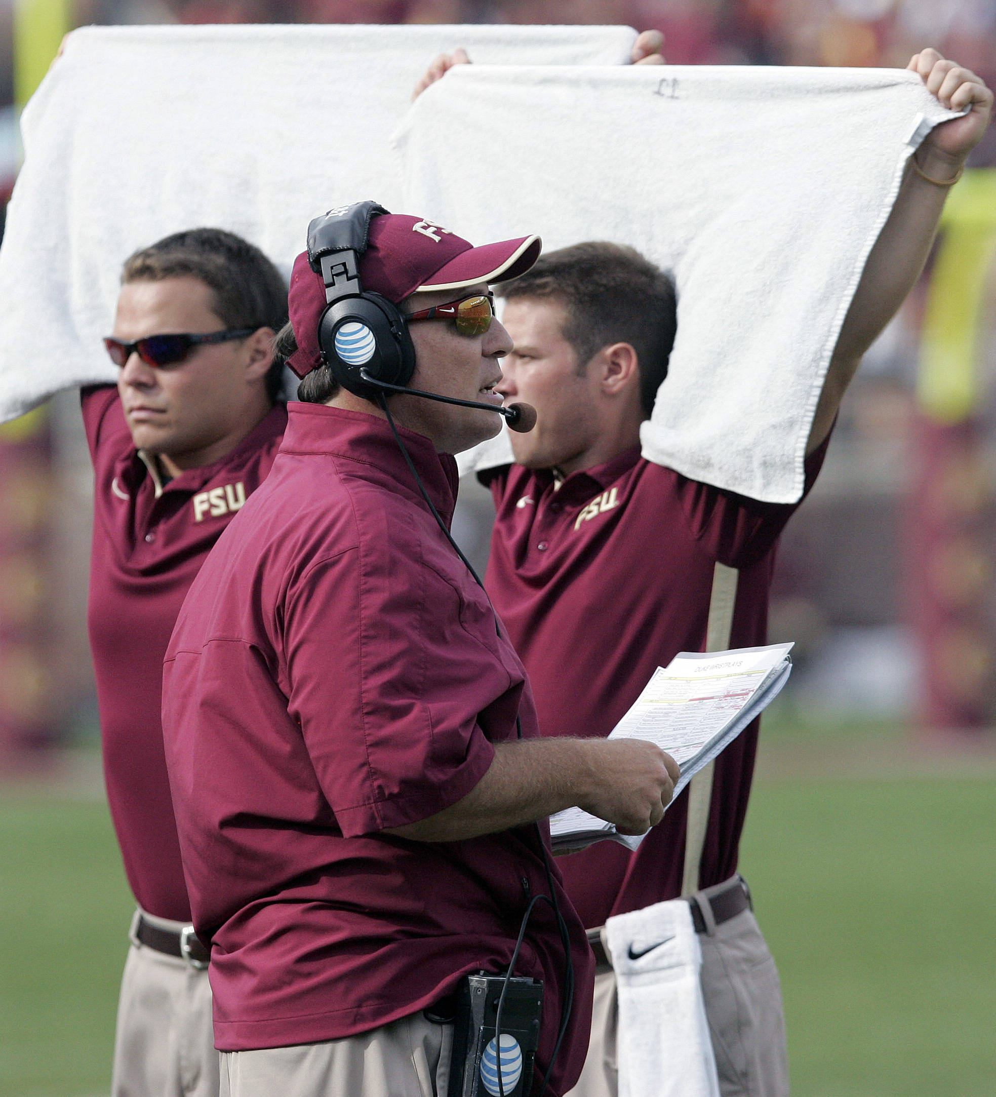 Florida State head coach Jimbo Fisher is shielded by towels as he calls a play against Duke in the first quarter. (AP Photo/Steve Cannon)