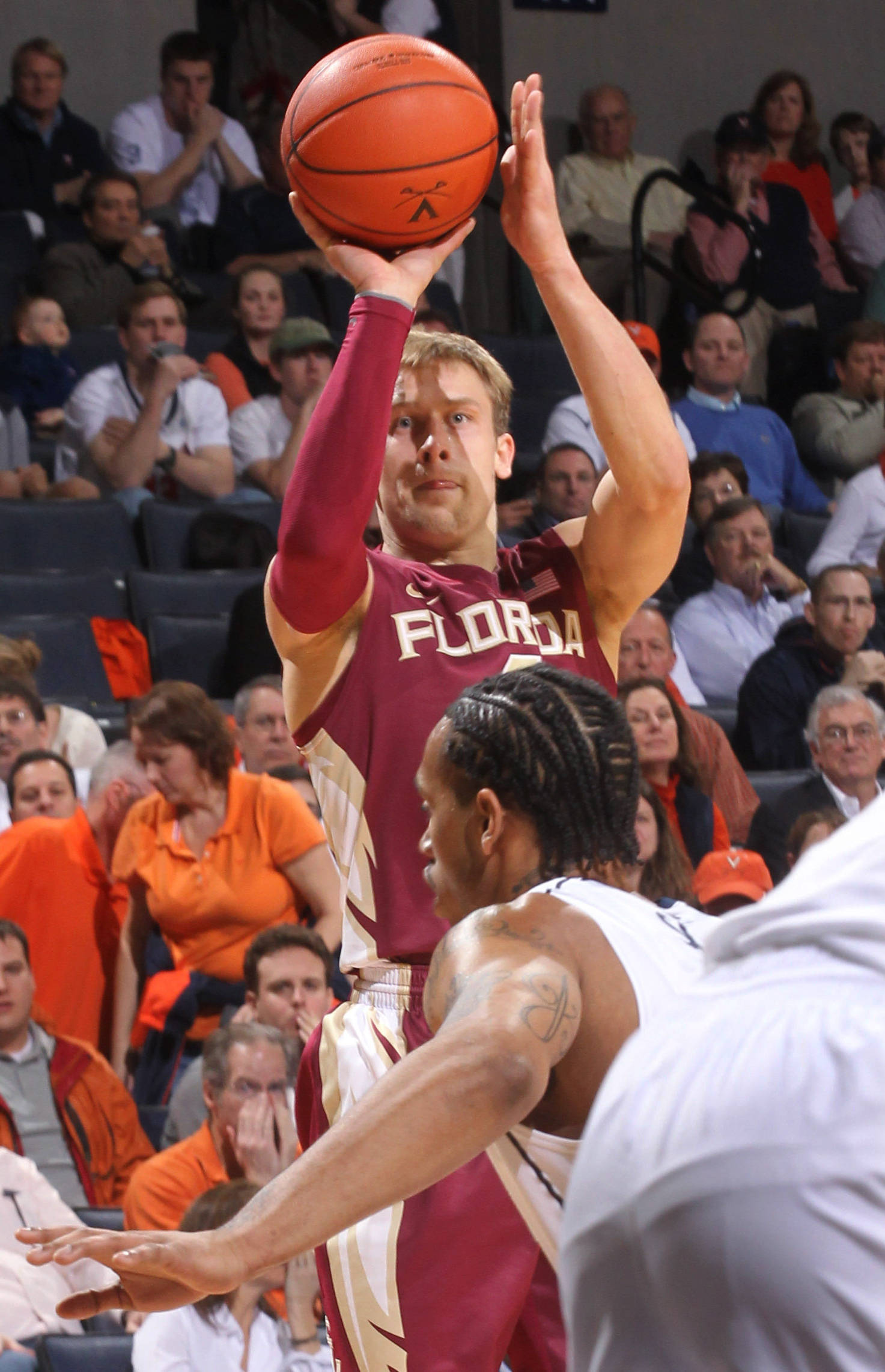 Florida State guard Deividas Dulkys shoots over Virginia forward Mike Scott during the first half. (AP Photo/Andrew Shurtleff)