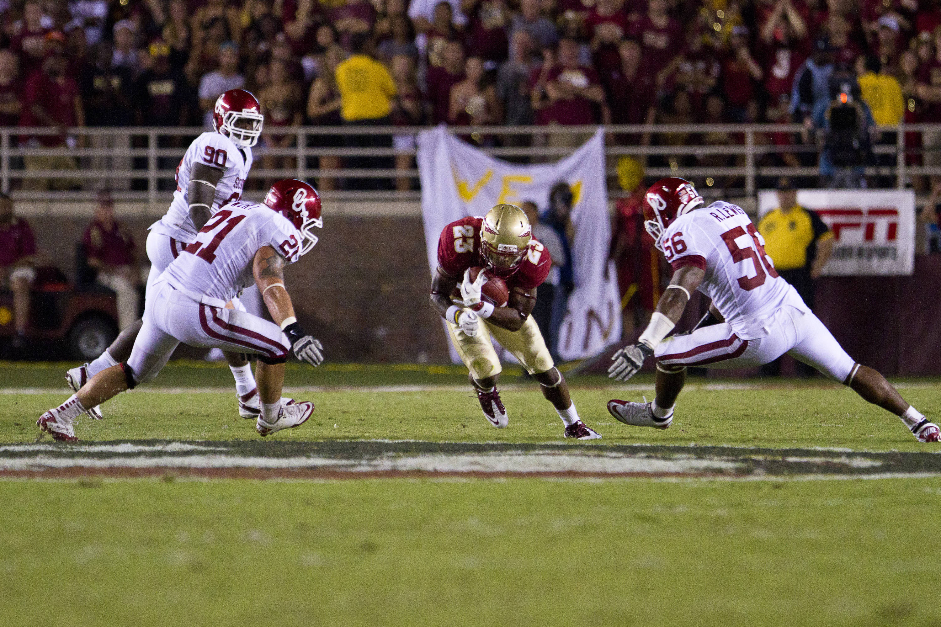 Chris Thompson (23) carries the ball between two defenders during the game against Oklahoma on September 17, 2011.